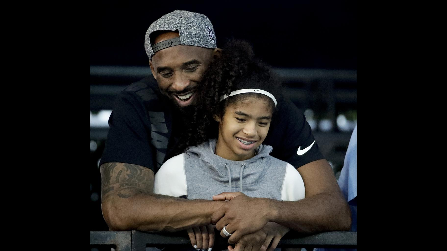 In this July 26, 2018 file photo former Los Angeles Laker Kobe Bryant and his daughter Gianna watch during the U.S. national championships swimming meet in Irvine, Calif. (AP Photo / Chris Carlson)
