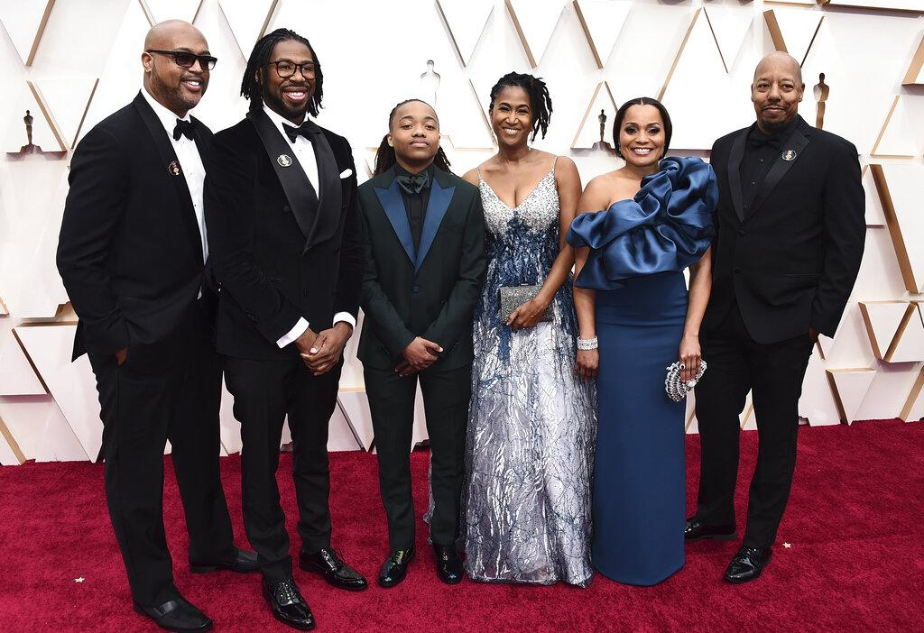 "Matthew A. Cherry, from second left, Deandre Arnold, his mother Sandy Arnold, second right, and the cast and the crew of ""Hair Love"" arrive at the Oscars on Sunday, Feb. 9, 2020, at the Dolby Theatre in Los Angeles. (Photo by Jordan Strauss / Invision / AP)"