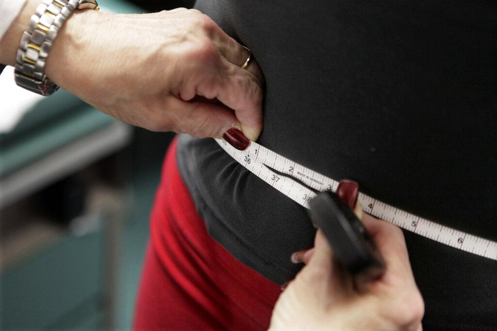 In this Jan. 20, 2010 file photo, a subject's waist is measured during an obesity prevention study in Chicago. (AP Photo / M. Spencer Green, File)