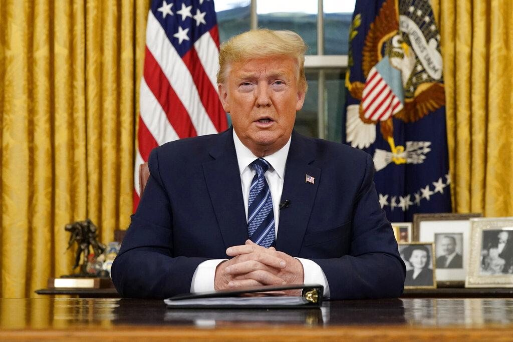 President Donald Trump speaks in an address to the nation from the Oval Office at the White House about the coronavirus Wednesday, March, 11, 2020, in Washington. (Doug Mills / The New York Times via AP, Pool)