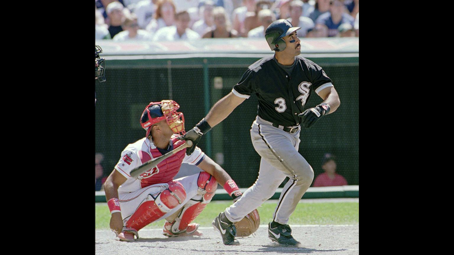 In this July 6, 1996, file photo, Chicago White Sox's Harold Baines (3) watches his ninth inning solo home run head for the center field seats during the White Sox's 3-2 win over the Cleveland Indians. (Jeff Glidden / AP File Photo)