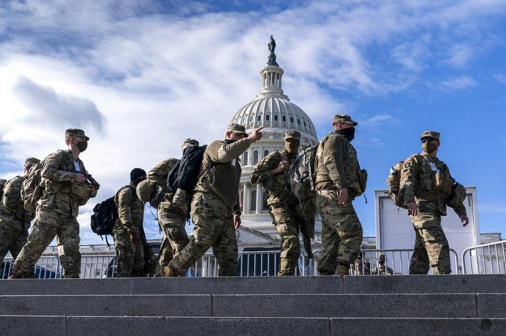 National Guard troops reinforce security around the U.S. Capitol ahead of the inauguration of President-elect Joe Biden and Vice President-elect Kamala Harris, Sunday, Jan. 17, 2021, in Washington. (AP Photo / J. Scott Applewhite)