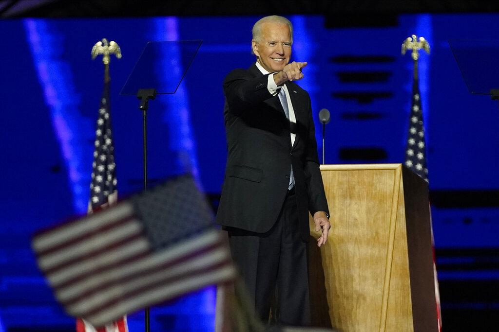President-elect Joe Biden gestures on stage after speaking, Saturday, Nov. 7, 2020, in Wilmington, Del. (AP Photo / Andrew Harnik, Pool)