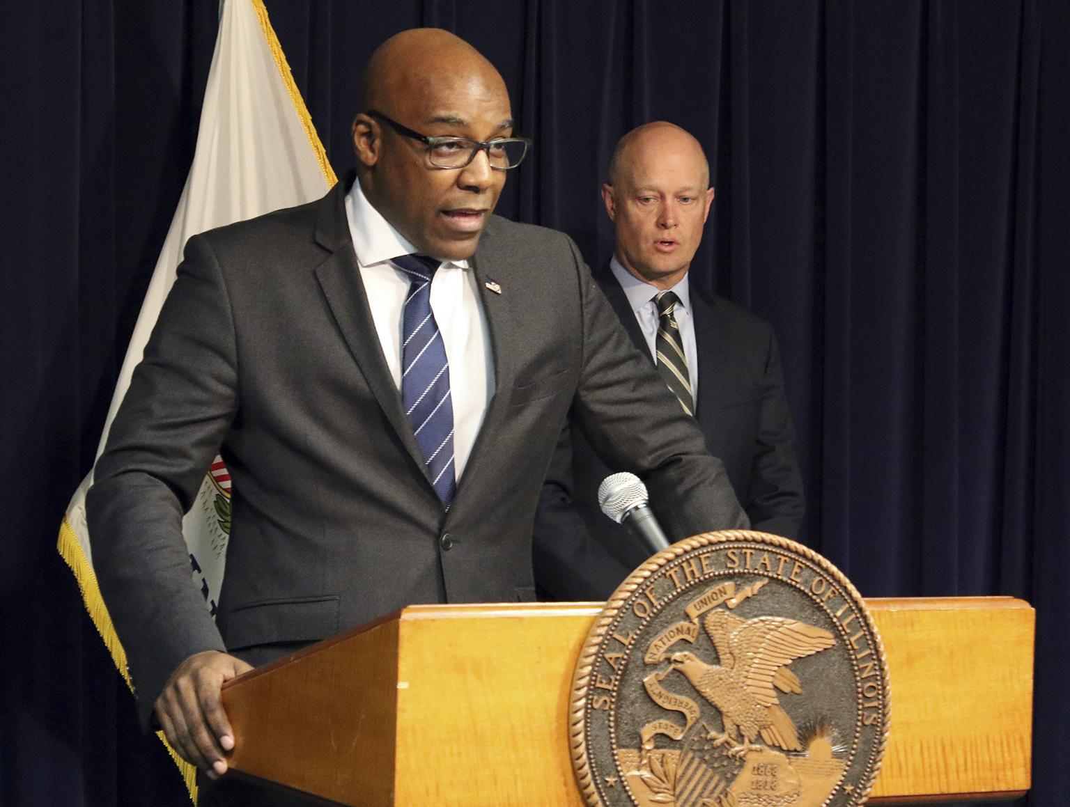 Attorney General Kwame Raoul, left, and Kane County State's Attorney Joseph McMahon speak during a news conference Monday, Feb. 11, 2019. (AP Photo / Noreen Nasir)