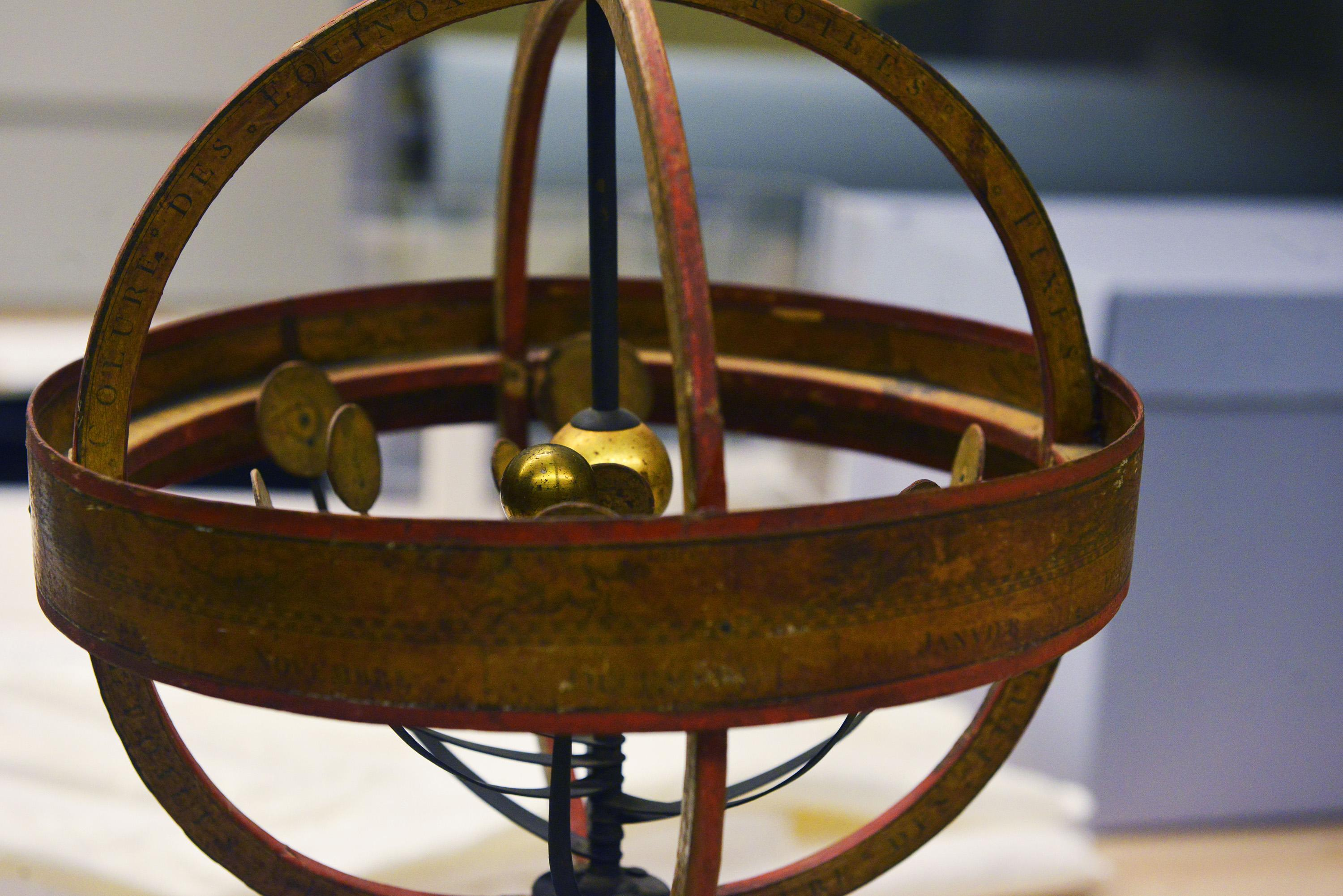 "Known as the Copernican Armillary Sphere, this instrument is a rough representation of the heliocentric solar system, with the sun at the center. The object is part of Adler Planetarium's ""What is a Planet?"" exhibit. (Courtesy Adler Planetarium)"
