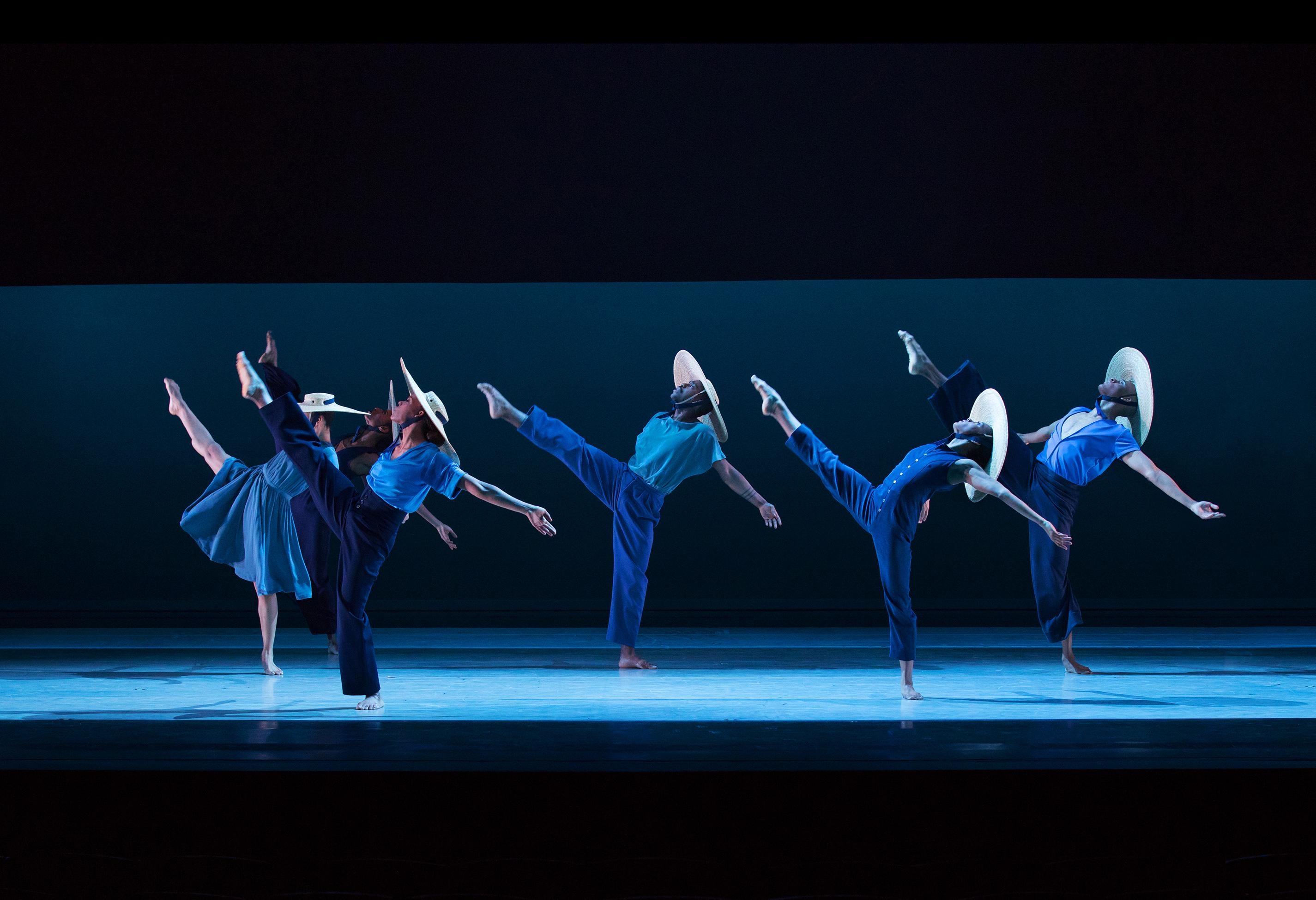 "Alvin Ailey American Dance Theater in Jamar Roberts' ""Members Don't Get Weary"" (Photo by Paul Kolnik)"