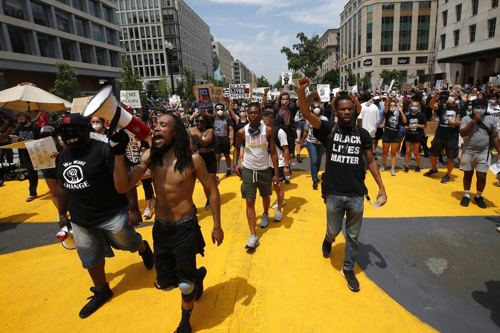 In this June 6, 2020, file photo, demonstrators protest near the White House in Washington over the death of George Floyd, a black man who was in police custody in Minneapolis. (AP Photo / Alex Brandon, File)
