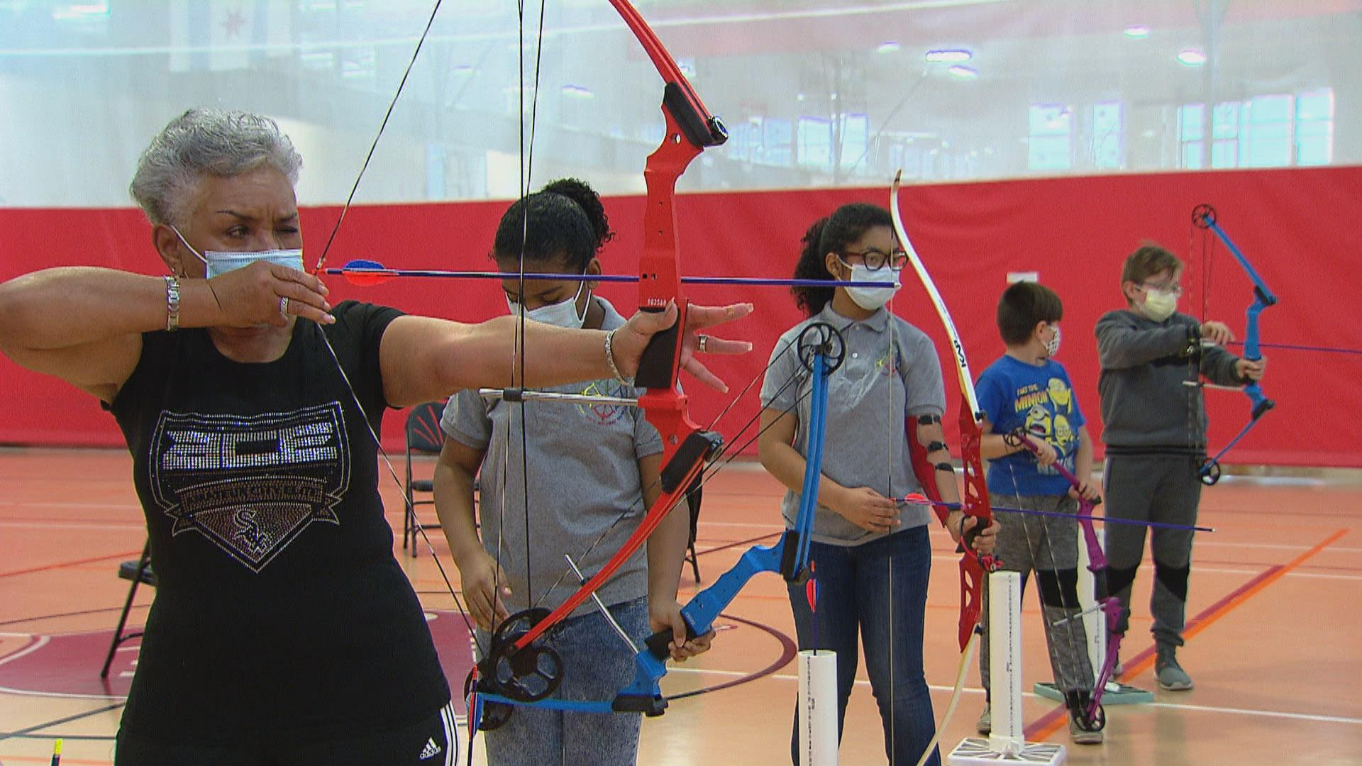 Archers practice their shooting during a lesson held by the Chicago Archery Club at the Kroc Center Chicago on Nov. 19, 2020. (WTTW News)