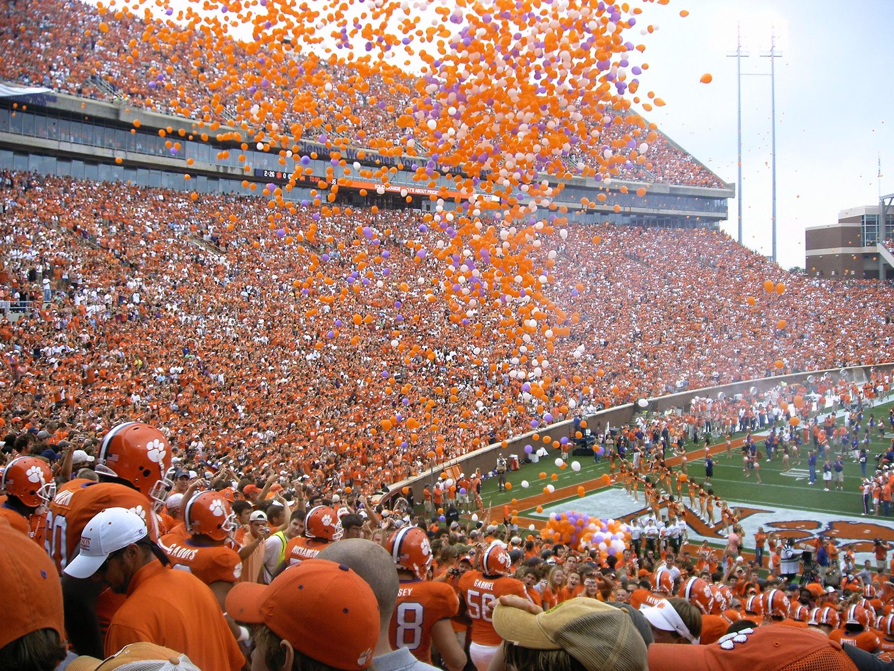 Clemson University ended a 30-year tradition of releasing thousands of orange balloons before football games last year after facing pressure from environmental and animal rights groups. (Jason A G / Flickr)