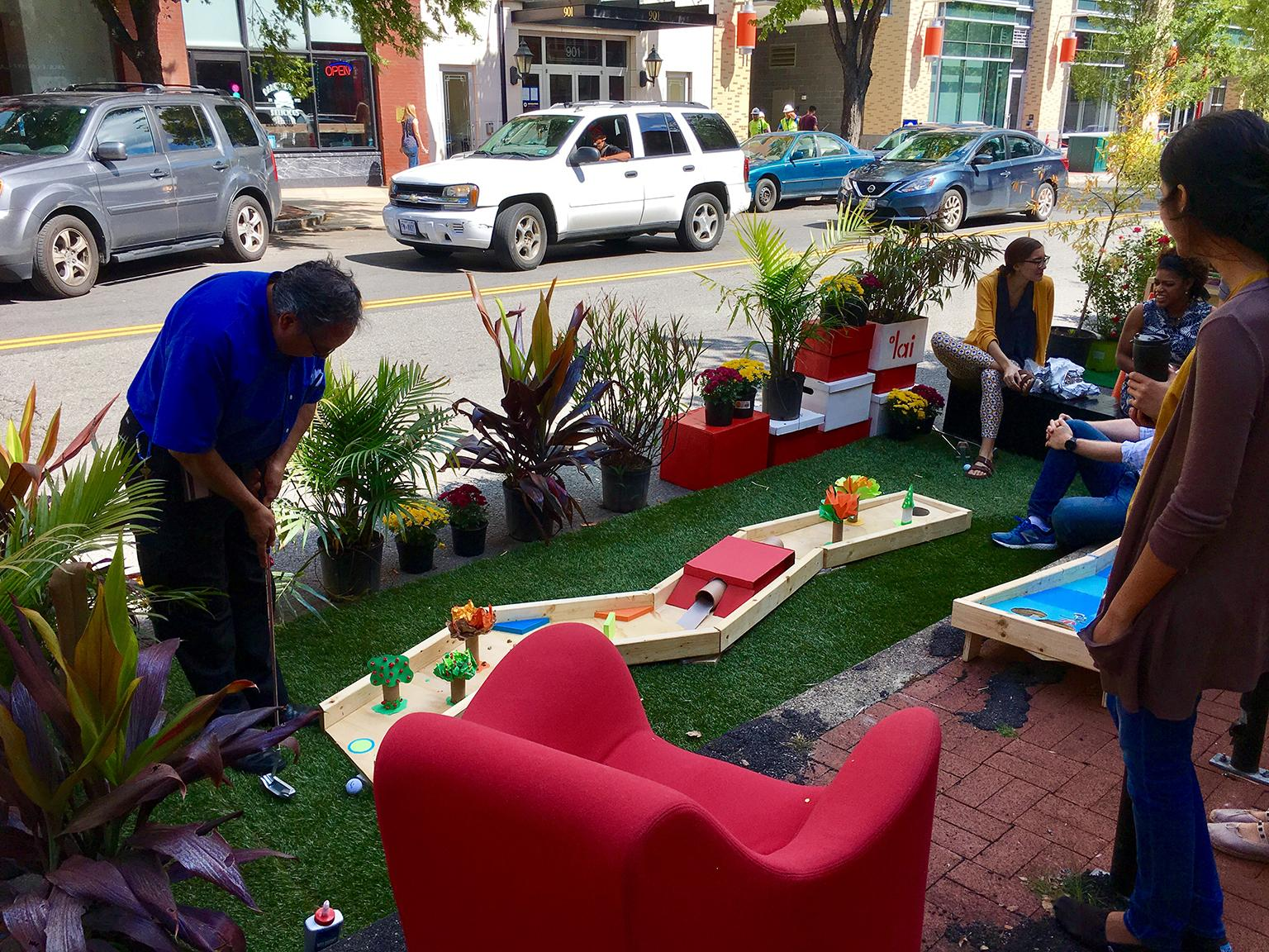 A miniature golf course takes over a parking space for PARK(ing) Day. (airbus777 / Flickr)
