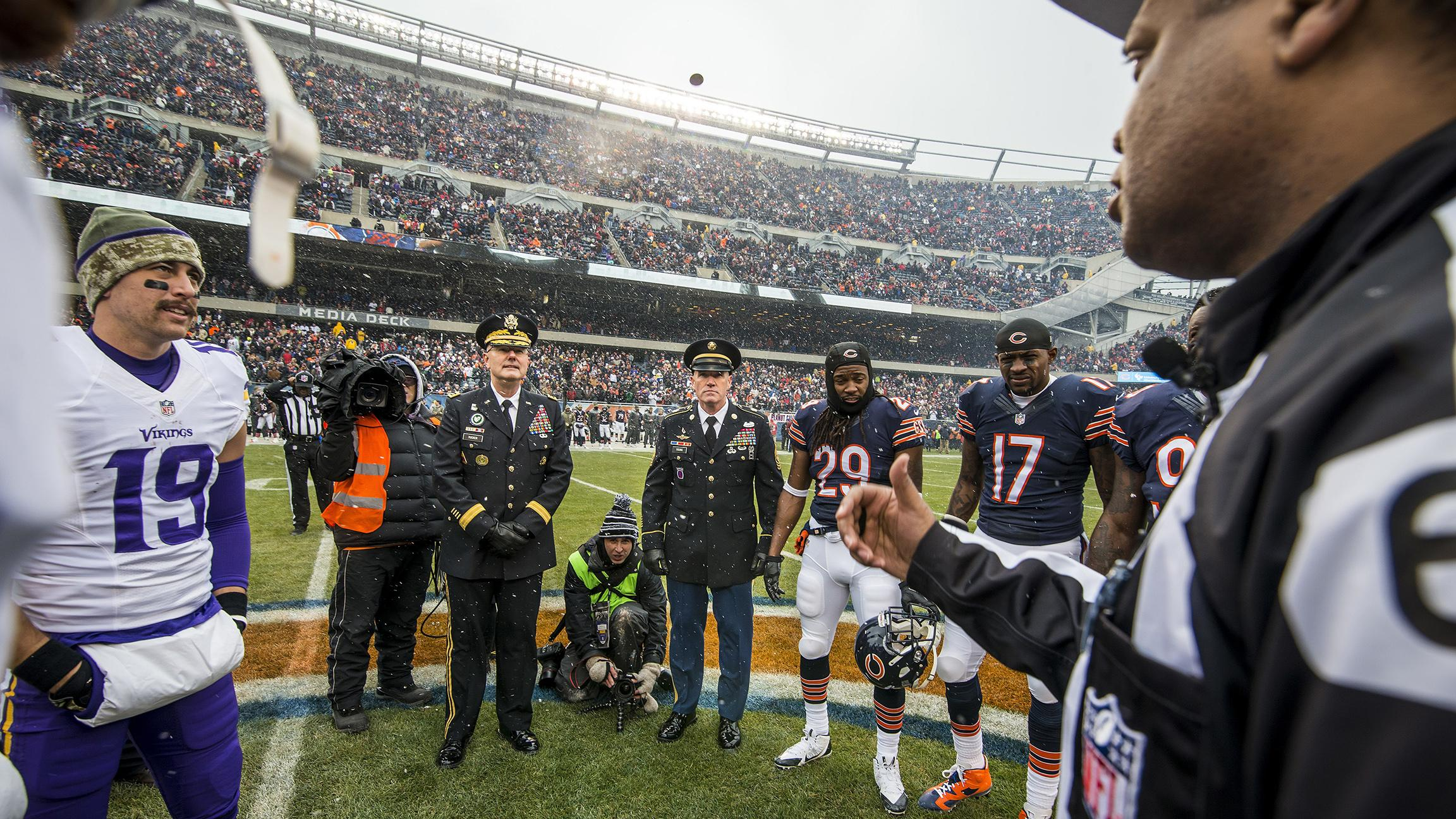 U.S. Army officers oversee a coin toss on Nov. 16, 2014 between the Chicago Bears and Minnesota Vikings at Soldier Field. (U.S. Army photo by Sgt. 1st Class Michel Sauret)
