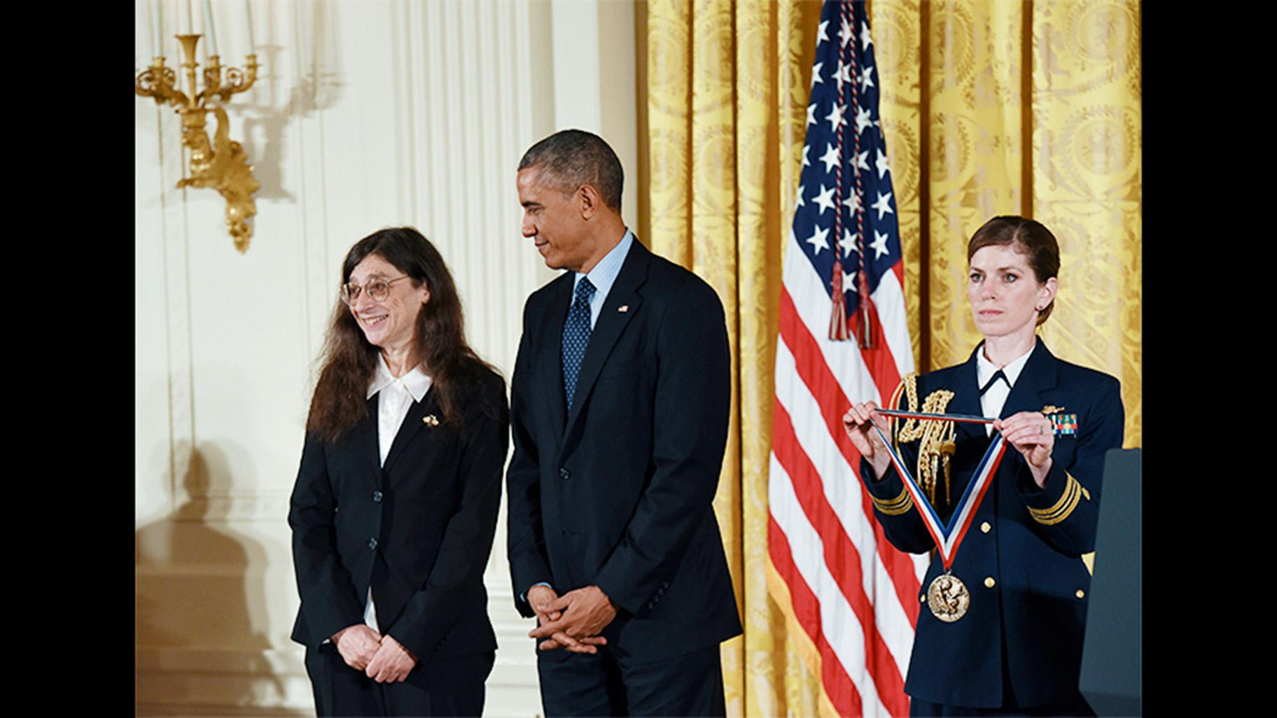 University of Illinois entomology professor May Berenbaum receives a National Medal of Science award from President Barack Obama at a White House ceremony on Nov. 20, 2014. (Courtesy National Science and Technology Medals Foundation)