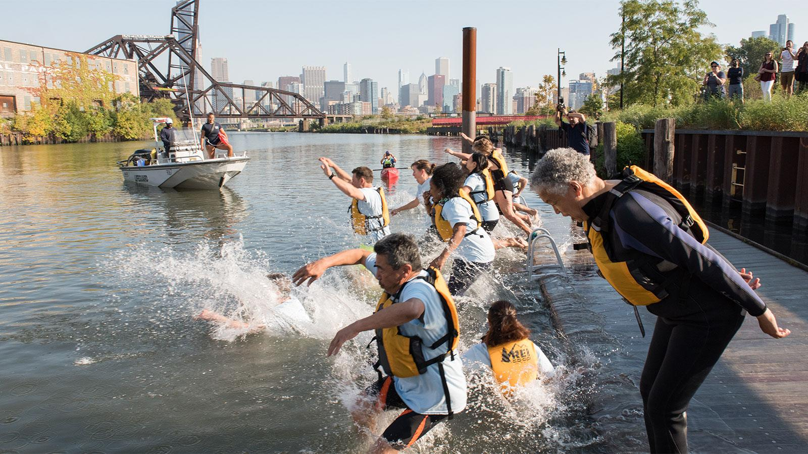 "Cook County Board President Toni Preckwinkle and other elected officials jump into the Chicago River during the ""Big Jump"" event in September 2017. (Courtesy Metropolitan Water Reclamation District)"
