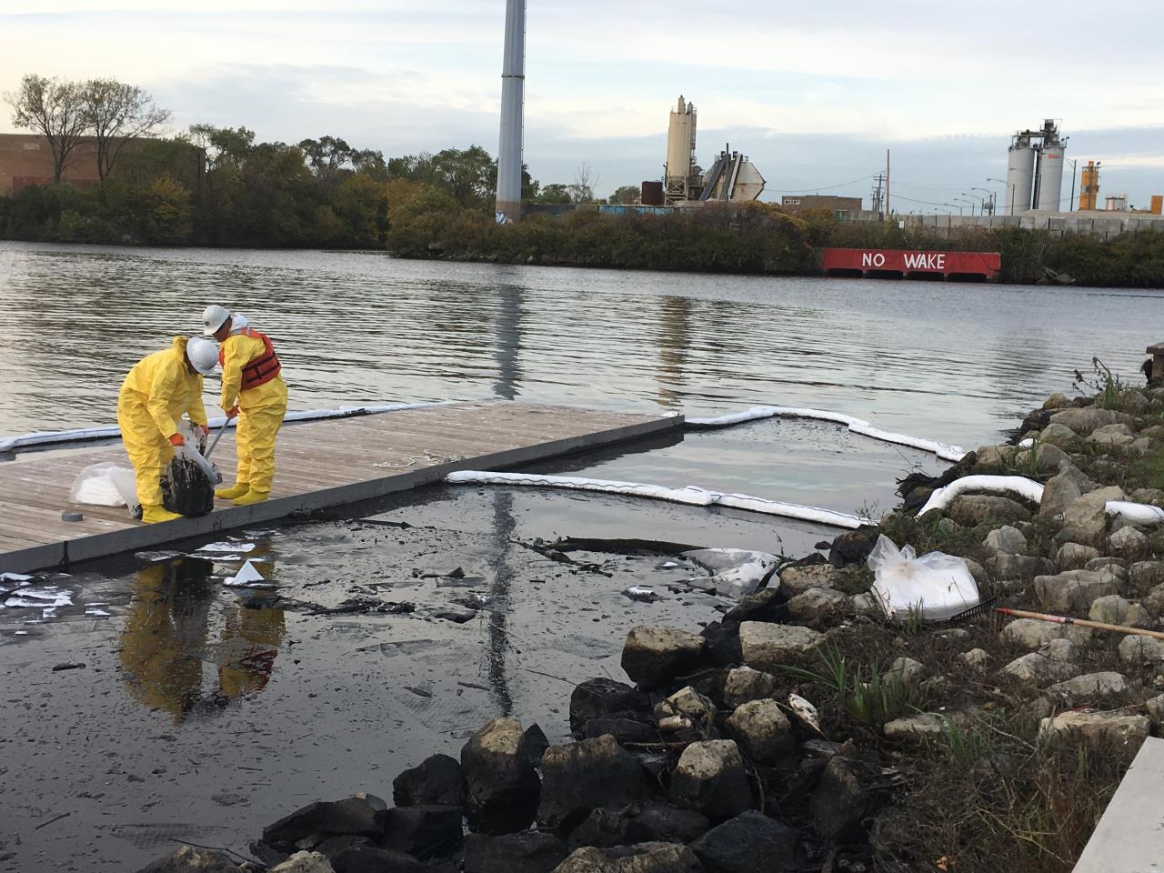 Workers from the Environmental Protection Agency respond to an oil spill Oct. 26 at a fork of the Chicago River known as Bubbly Creek. (EPA)