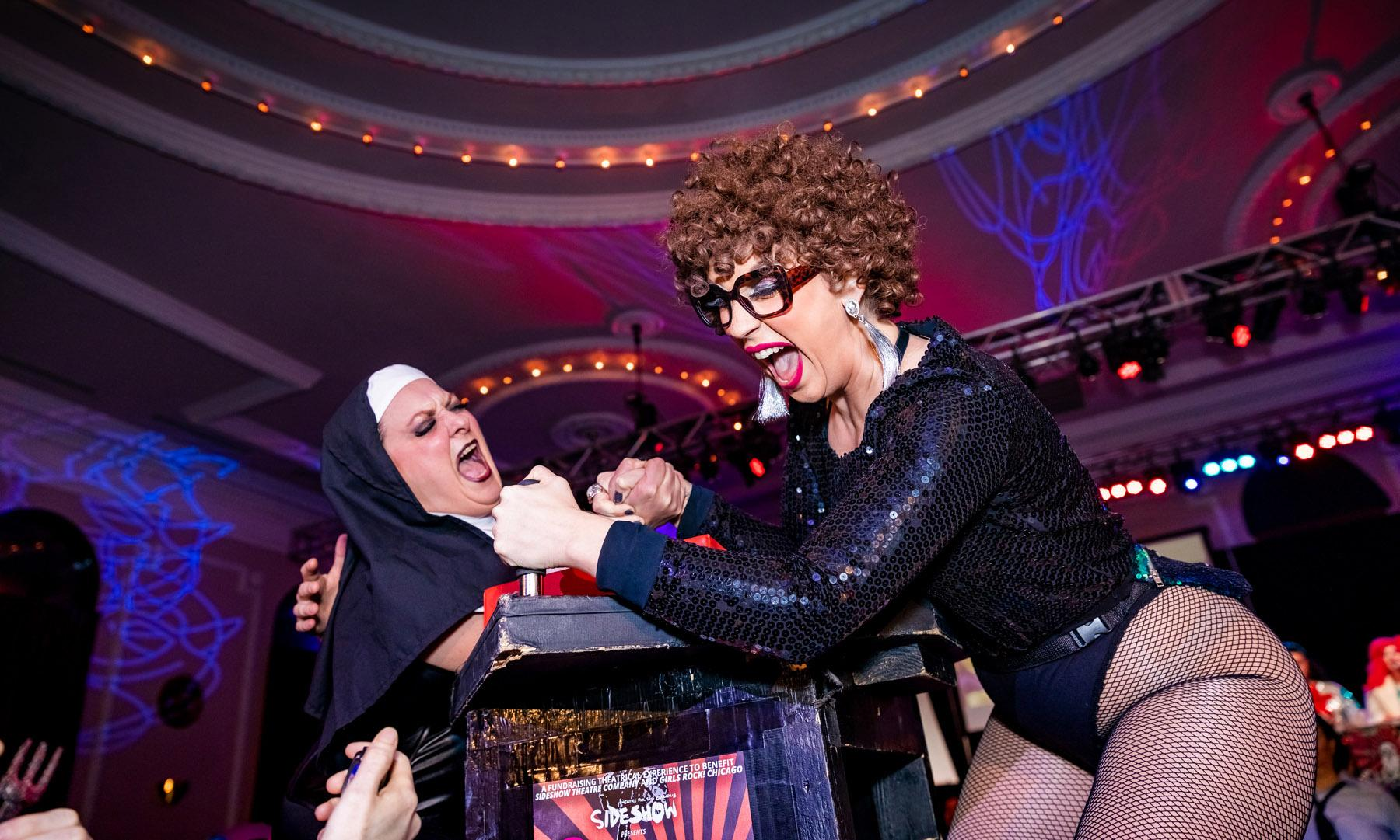 Sister Frida Rage (left) vs. Aunt Nance at The Chicago League of Lady Arm Wrestlers' 34th match CLLAW XXXIV: Good vs. Evil at Logan Square Auditorium. (Photo by Trainman Photography)