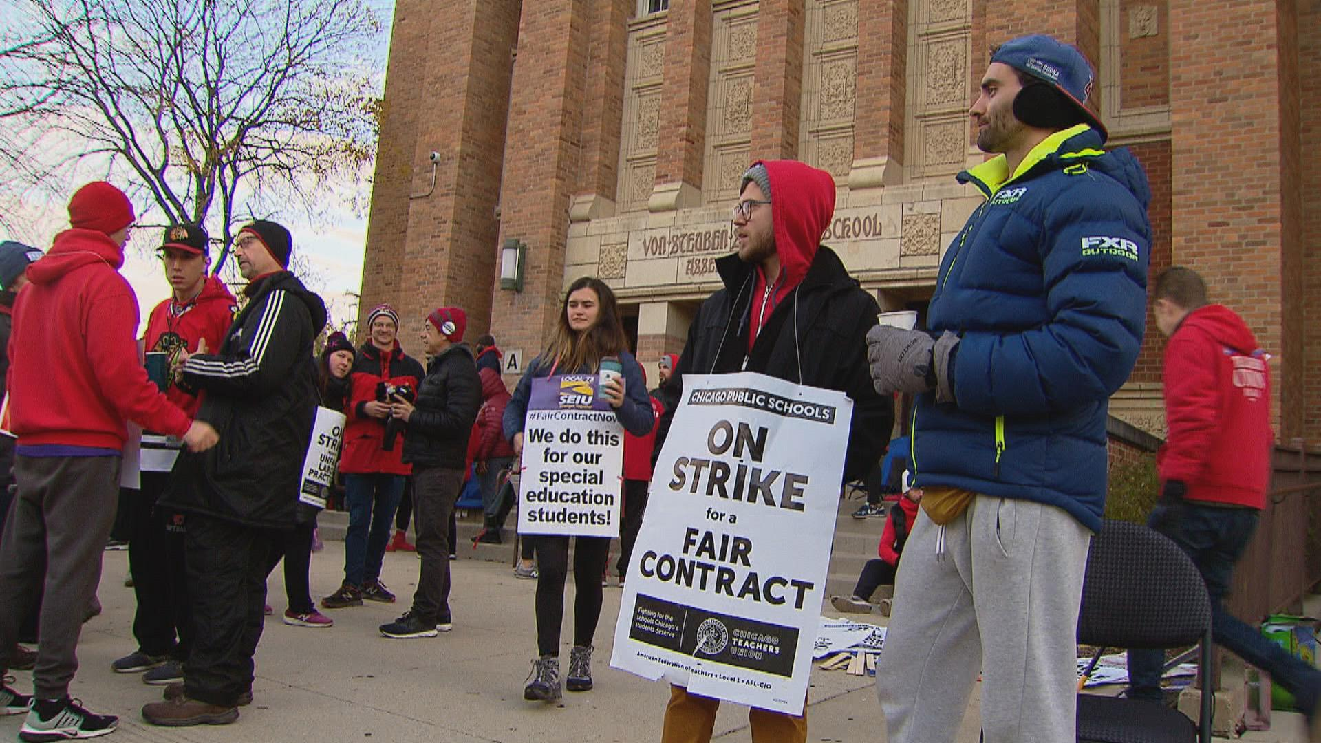 Striking teachers at Chicago Public Schools gather outside a CPS school on the city's North Side on Monday, Oct. 28, 2019, day eight of the Chicago teachers strike. (WTTW News)