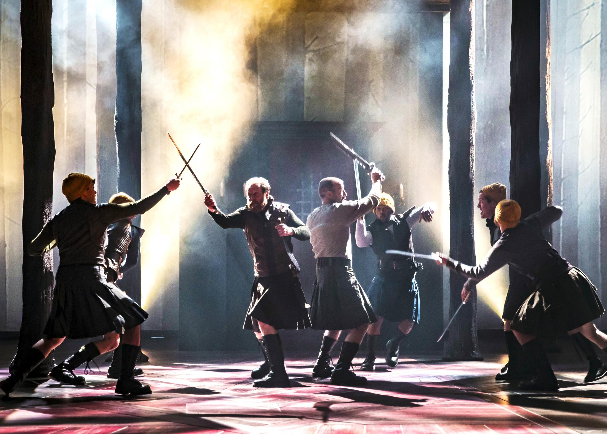 "Macbeth (Ian Merrill Peakes, right center) and Banquo (Andrew White, left center) engage in the battle for Scotland in ""Macbeth."" (Photo by Liz Lauren)"