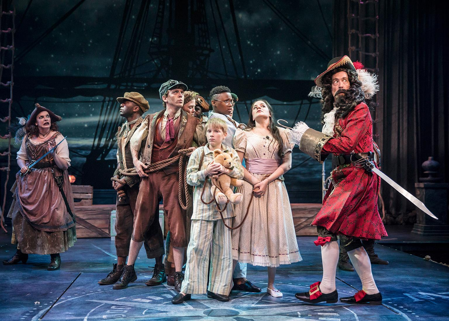 "Captain Hook (James Konicek) taunts the captured Lost Boys and Darling siblings, with the help of Starkey (Christina Hall) in ""Peter Pan – A Musical Adventure."" (Photo by Liz Lauren)"