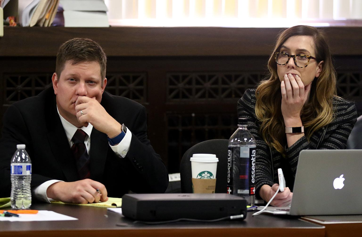 Chicago police Officer Jason Van Dyke and defense attorney Elizabeth Fleming listen to testimony Wednesday, Sept. 26, 2018 during the seventh day of the trial. (John J. Kim / Chicago Tribune / Pool)