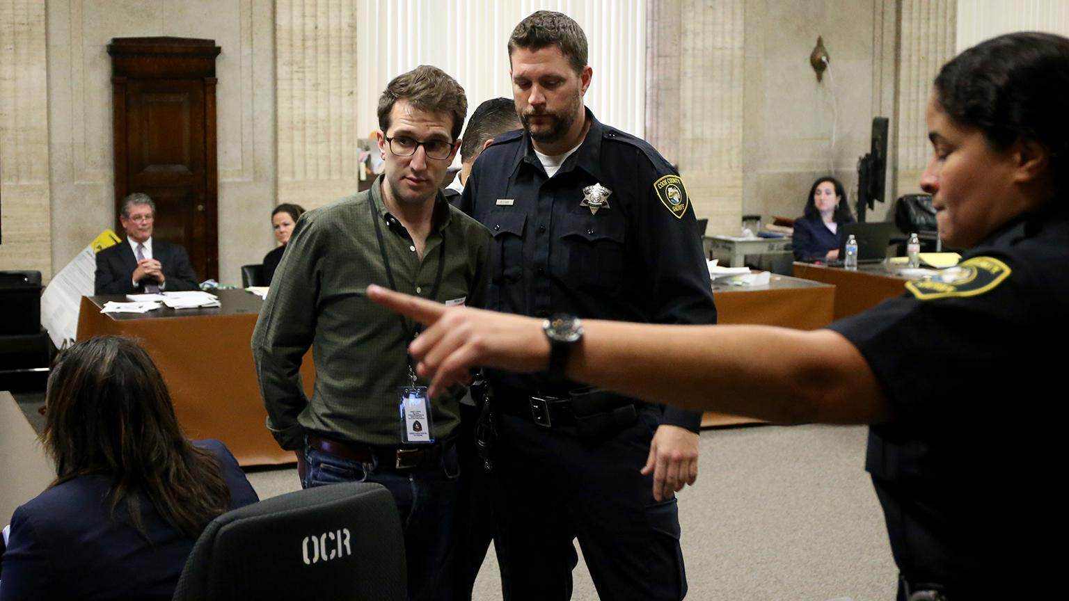 Zachary Siegel is taken into custody for recording testimony Tuesday, Oct. 2, 2018 in the courtroom. Antonio Perez / Chicago Tribune / Pool)