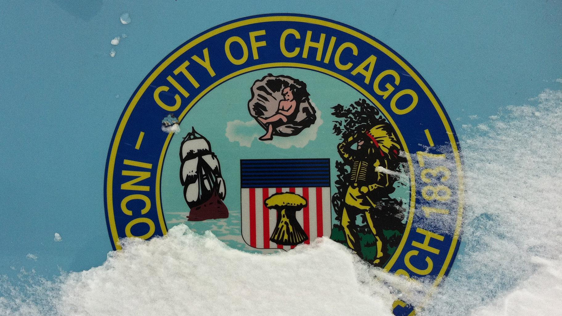 This file photo shows a City of Chicago seal on the side of a salt truck. (t3xt (talk) / Wikimedia Commons)