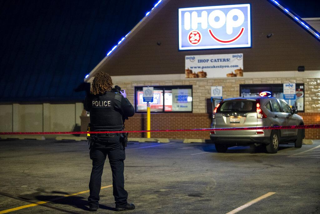 Chicago and Evanston police investigate the scene of a shooting outside an IHOP restaurant in Evanston on Saturday night, Jan. 9, 2021. (Ashlee Rezin Garcia / Chicago Sun-Times via AP)