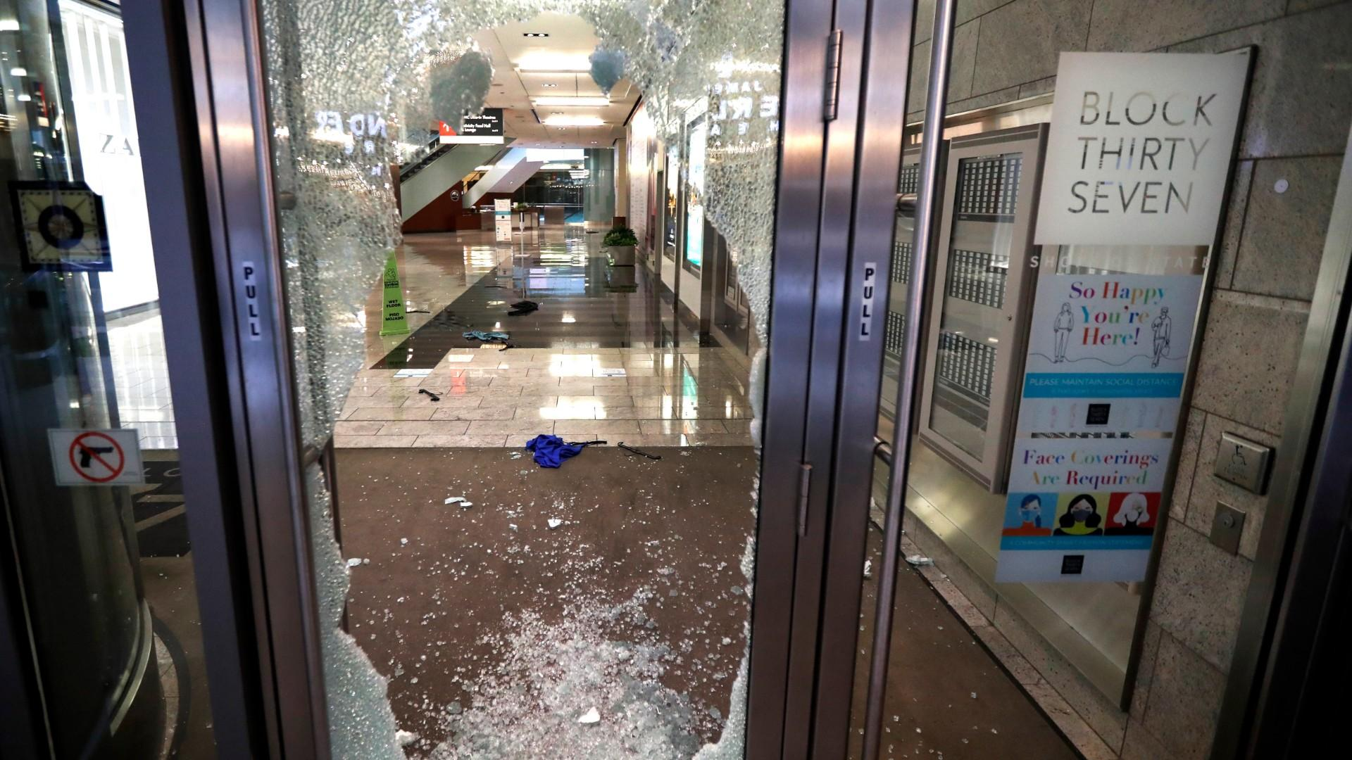 A door to the Block 37 retail building is shattered Monday, Aug. 10, 2020, after vandals struck overnight in Chicago's famed Loop. (AP Photo / Charles Rex Arbogast)