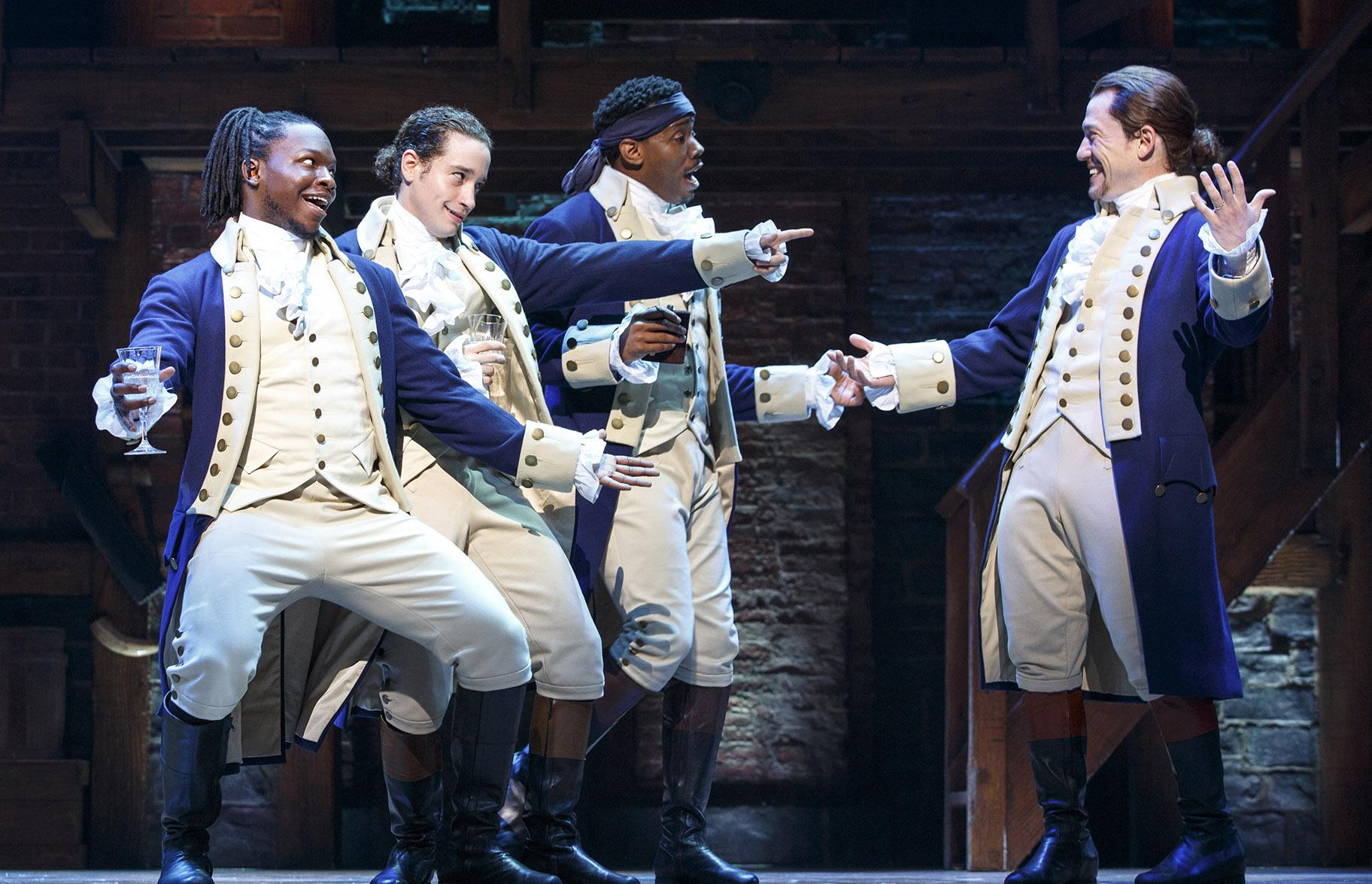 "From left: Chris De'Sean Lee, Jose Ramos, Wallace Smith and Miguel Cervantes in ""Hamilton."" (Courtesy of Joan Marcus)"