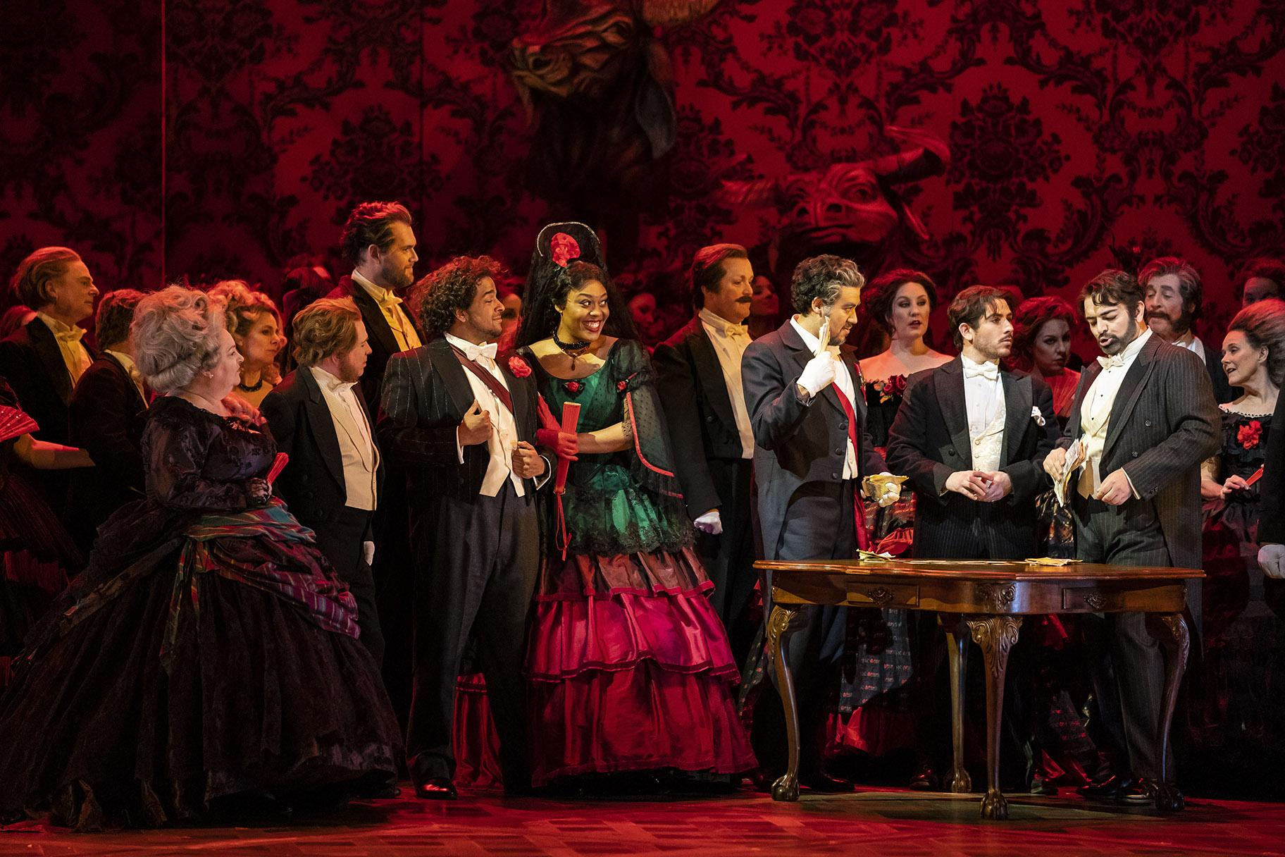"Christopher Kenney, Zoie Reams, Ricardo Jose Rivera, Mario Rojas and Giorgio Berrugi in ""La Traviata"" (Credit: Todd Rosenberg)"