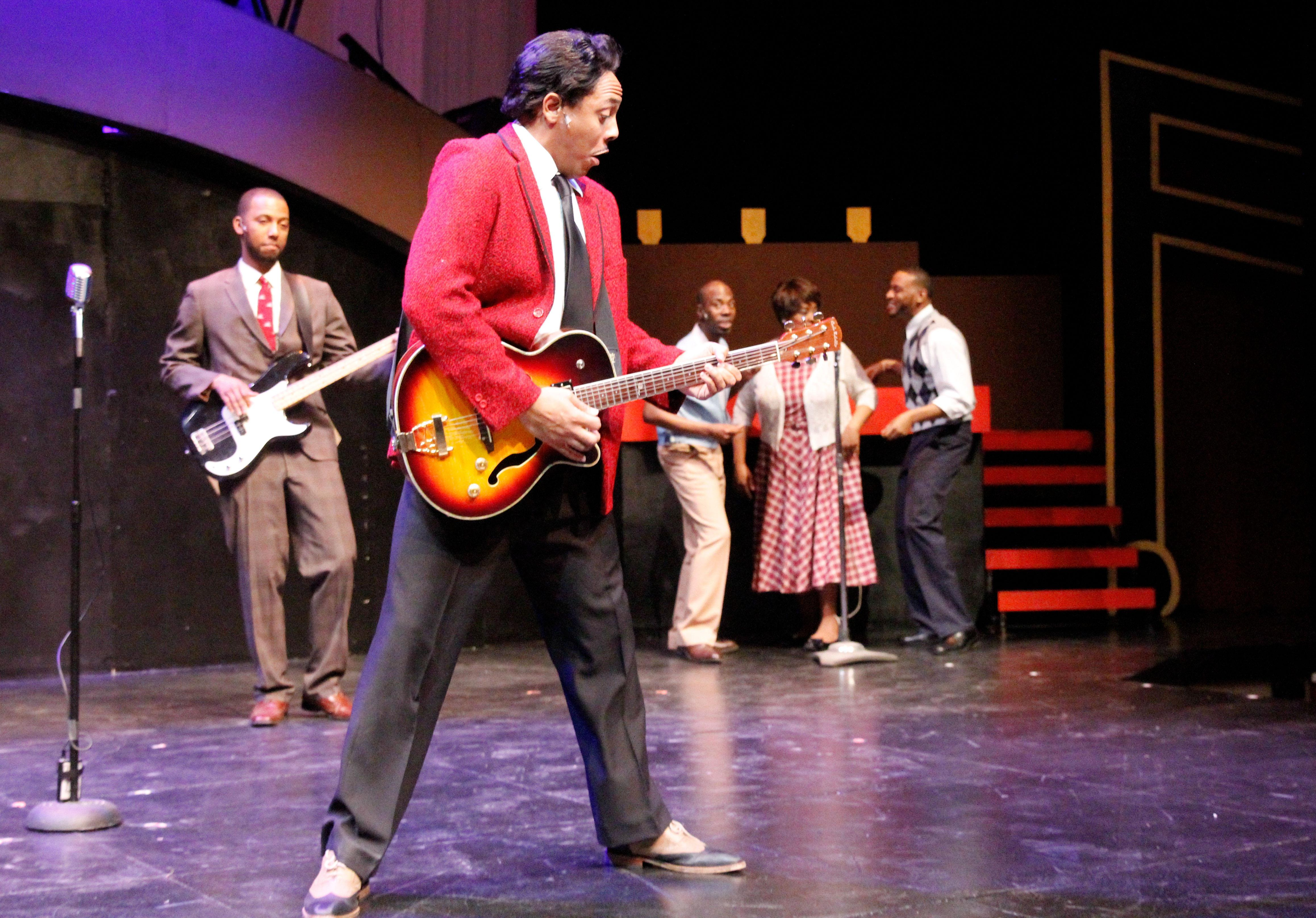 "Vincent Jordan, center, as Young Chuck Berry in Black Ensemble Theater's ""Hail, Hail Chuck: A Tribute to Chuck Berry."" (Credit: Alan Davis)"