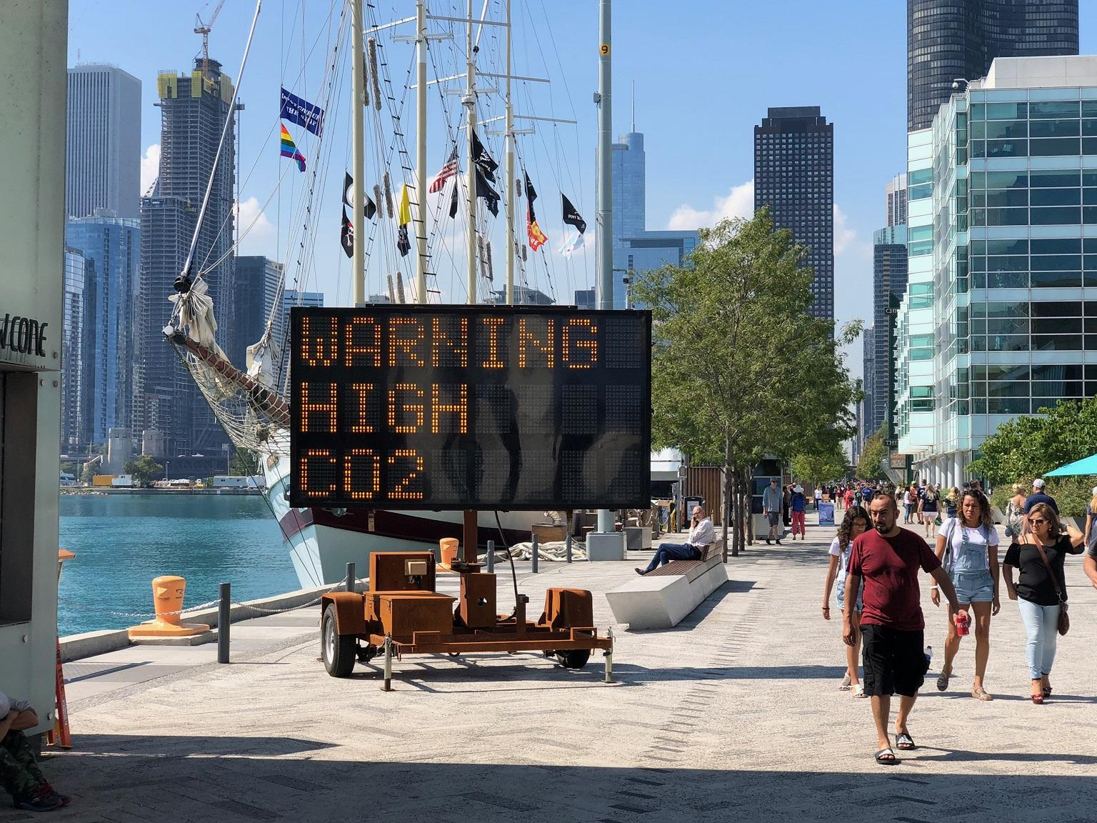 A new art installation at Navy Pier uses a solar-powered highway message board to warn of the dangers of climate change. (Alex Ruppenthal / Chicago Tonight)