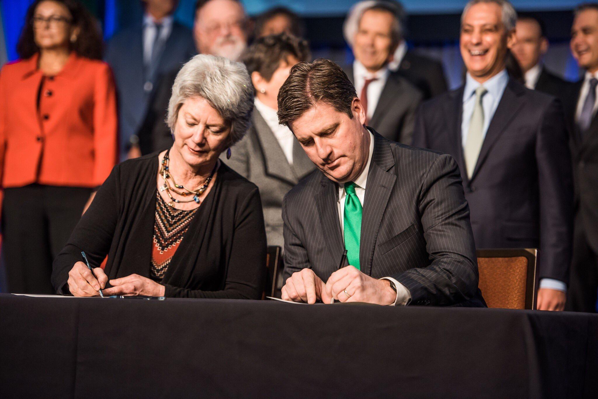 Pittsboro, N.C. Mayor Cindy Perry and Pittsburgh Mayor Bill Peduto sign the Chicago Climate Charter on Tuesday. (Courtesy City of Pittsburgh)