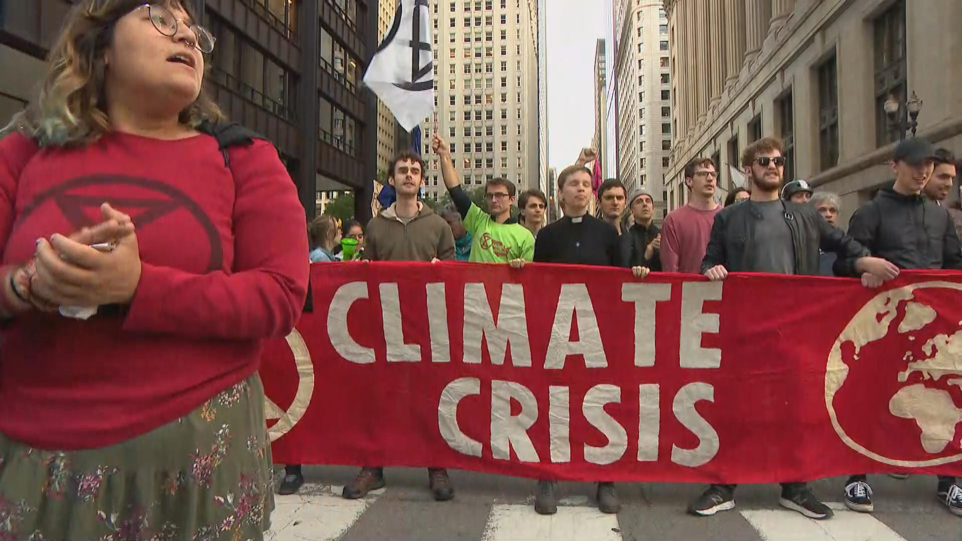 "Activists on the evening of Monday, Oct. 7, 2019 closed down the streets in front of Chicago City Hall and the James R. Thompson Center as they called on Mayor Lori Lightfoot and Gov. J.B. Pritzker to declare a ""climate emergency."" (WTTW News)"
