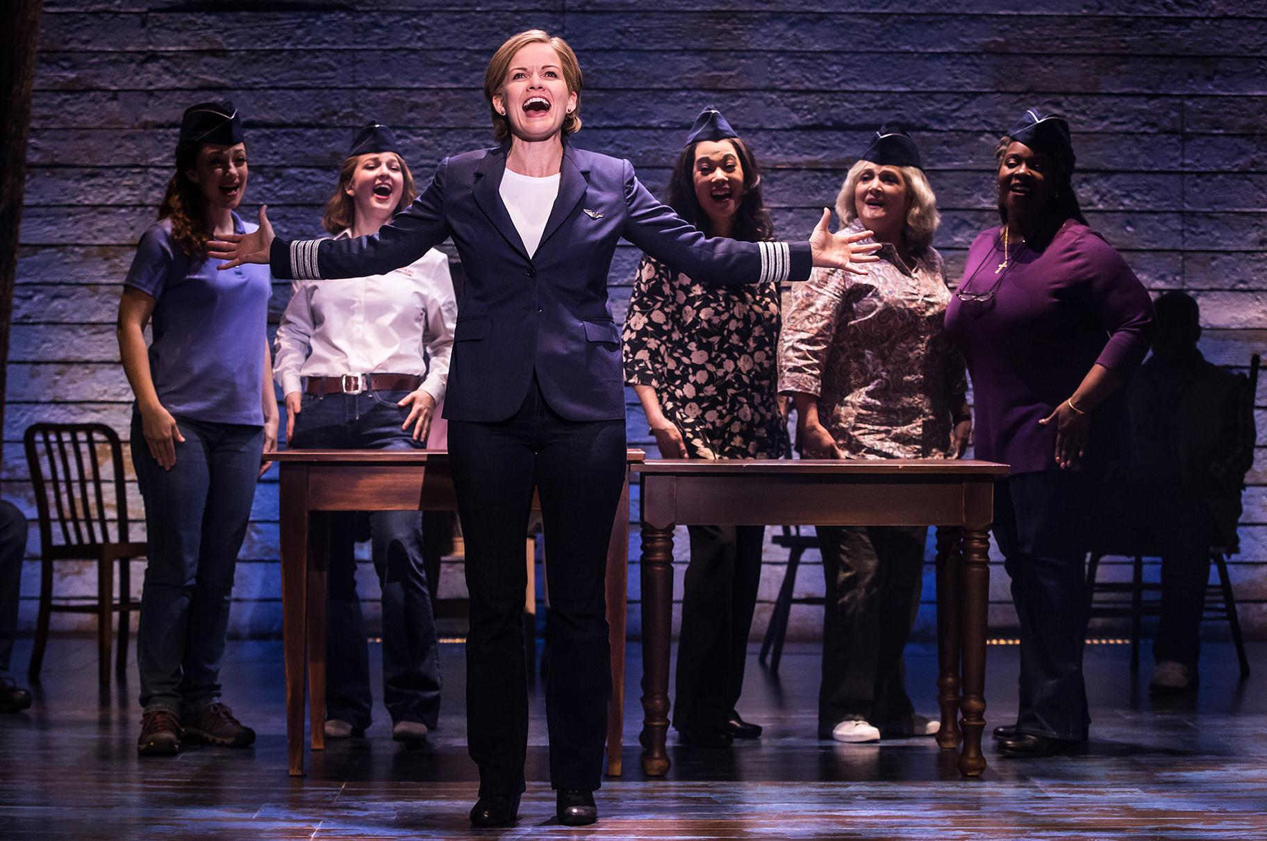 "In ""Come From Away,"" Becky Gulsvig plays Beverley, the pilot who worked long and hard to become the first female captain to fly for American Airlines. (Photo Credit: Matthew Murphy)"