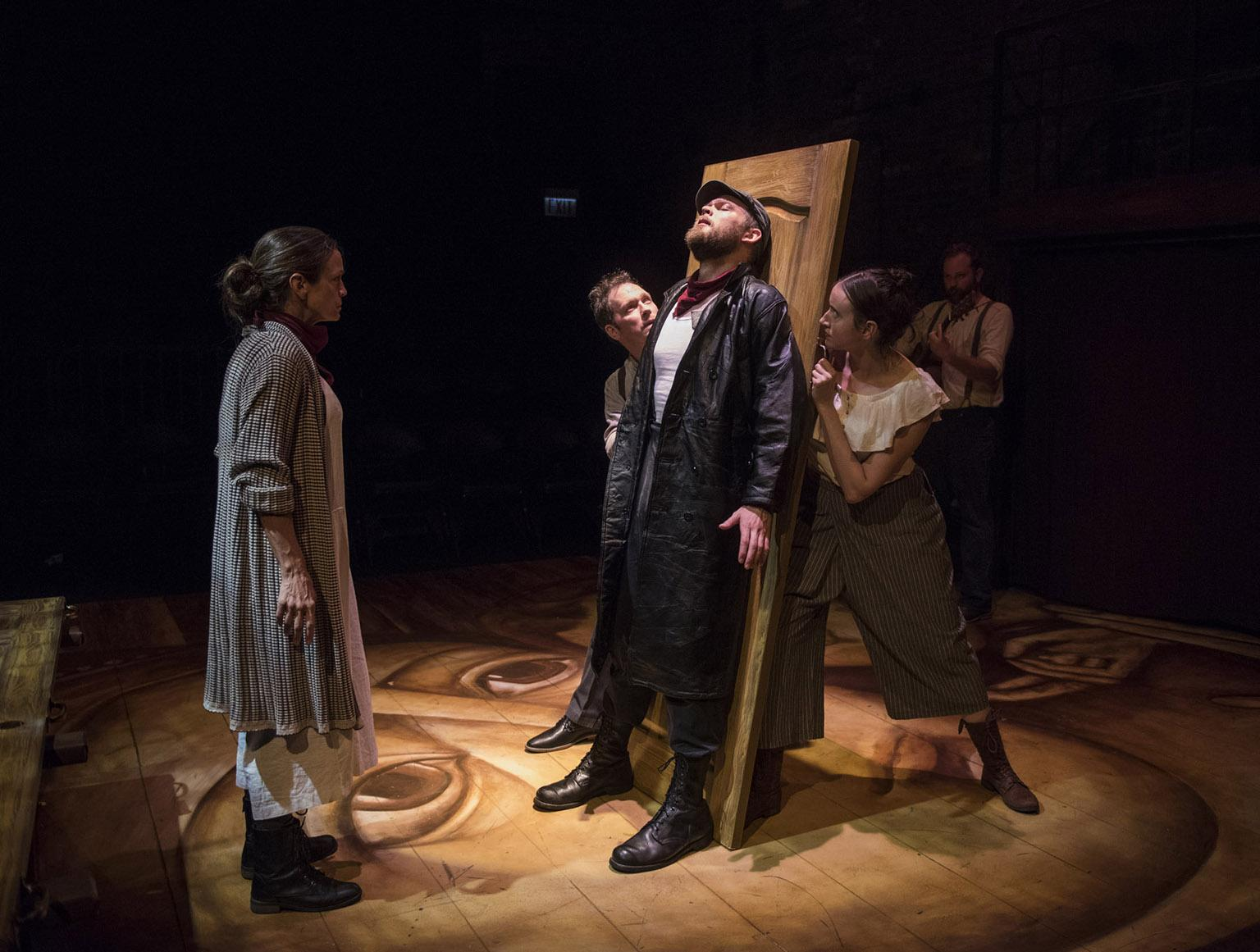 "(From left) Rebecca Jordan, Brad Woodard, Drew Schad, Christina Gorman and Joseph Wiens in Shattered Globe Theatre's new adaptation of ""Crime and Punishment."" (Photo by Michael Brosilow)"