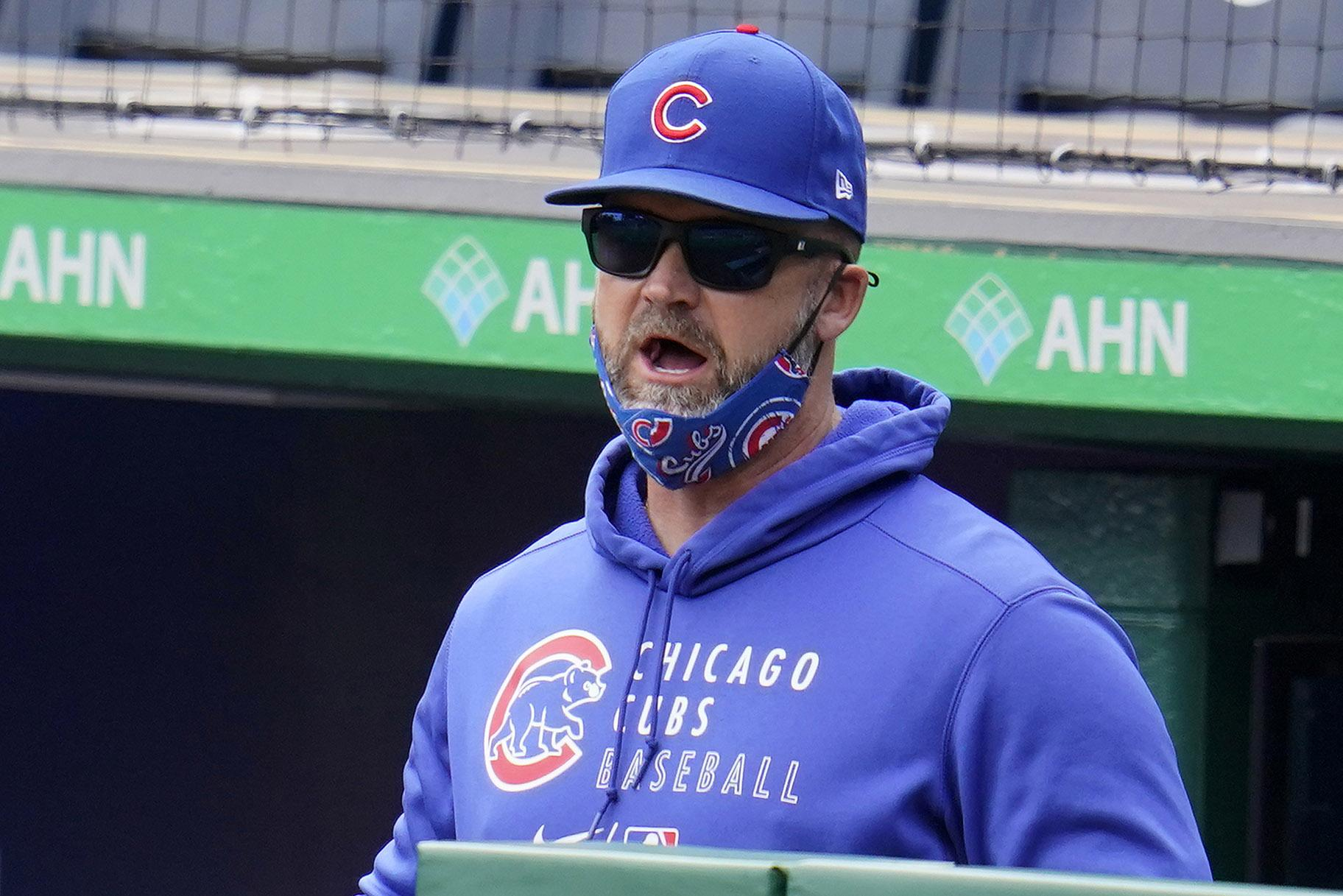 Chicago Cubs manager David Ross stands in the dugout during a baseball game against the Pittsburgh Pirates in Pittsburgh, Sunday, April 11, 2021. (AP Photo / Gene J. Puskar)