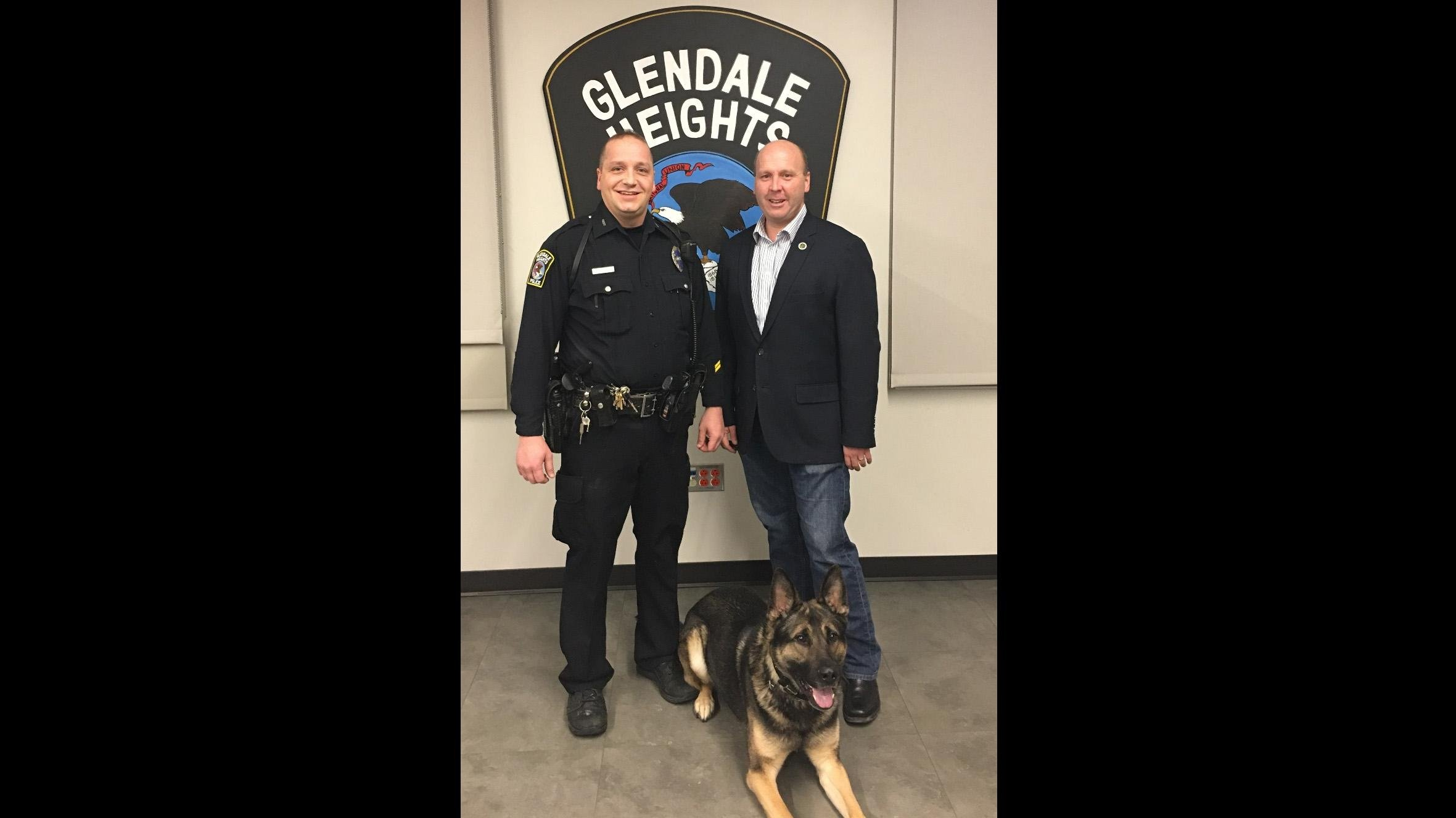 State Sen. Tom Cullerton, right, poses with Glendale Heights Police Officer Mike Huff and K9 Officer Orkan. (State Sen. Tom Cullerton)