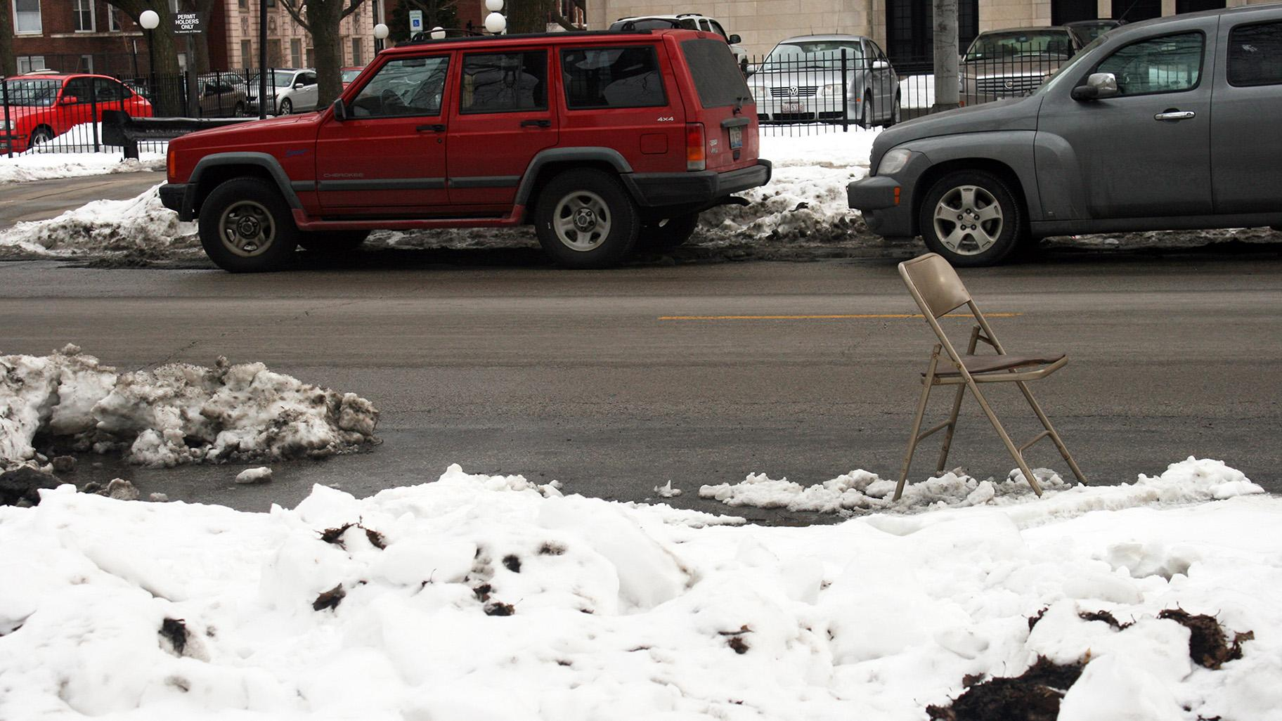 A folding chair holds a parking spot cleared of snow on Feb. 12, 2011 in Chicago. (Quinn Dombrowski / Flickr)