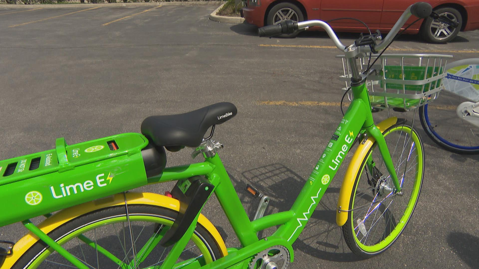 Each vendor participating in Chicago's Dockless Bike Share Pilot Project offers its own look. Some of the bikes, like this lime green model, are electric. (Chicago Tonight)