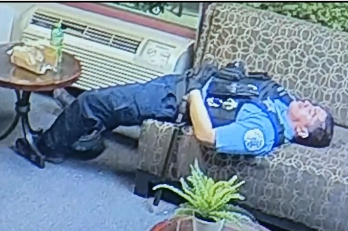 A screenshot from a video shown to the media on Thursday, June 11, 2020 shows a Chicago police officer lying down inside the office of U.S. Rep. Bobby Rush. (WTTW News via City of Chicago)