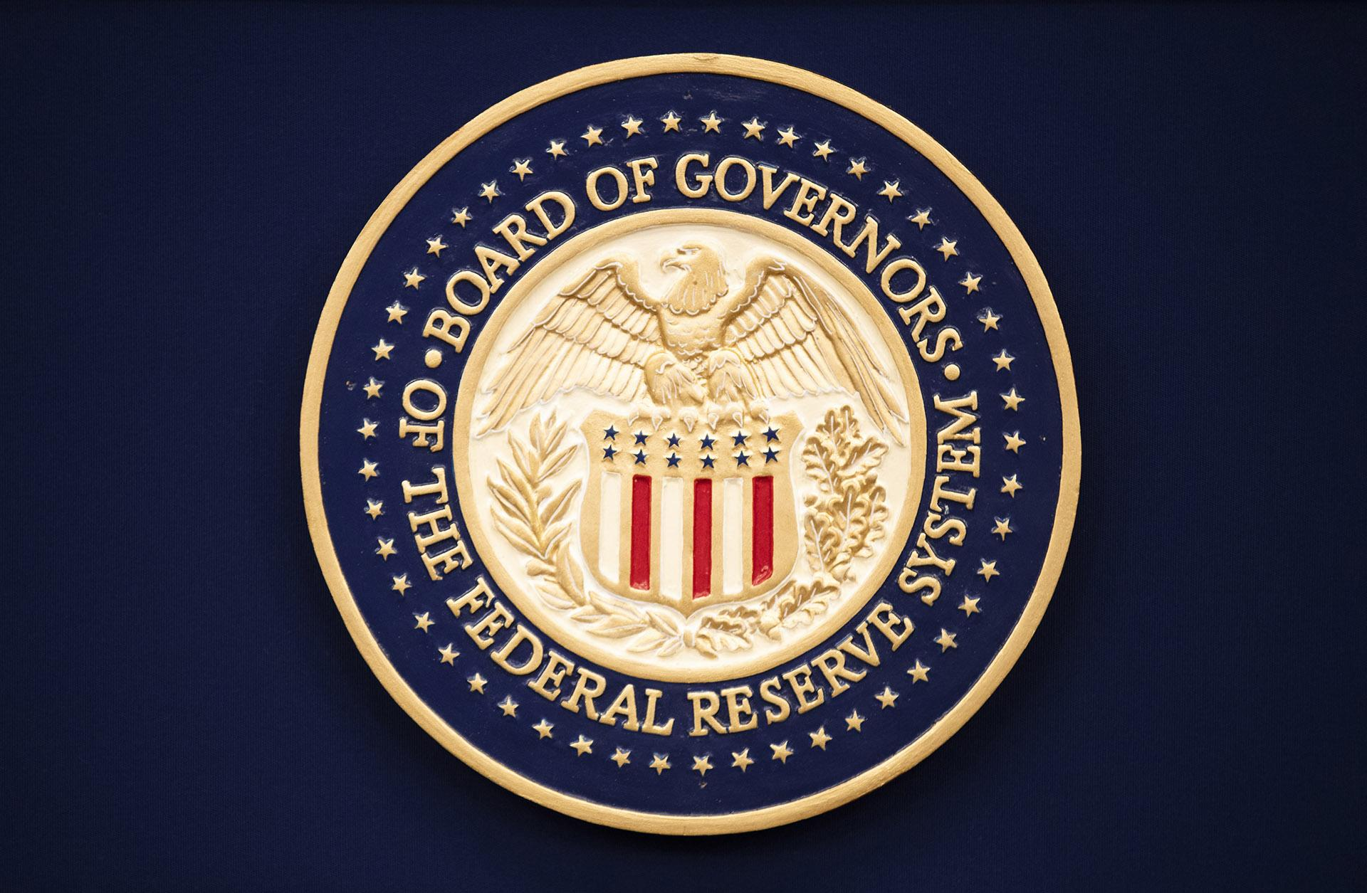 In this July 31, 2019 file photo, The Federal Reserve logo is shown before the start of a scheduled news conference by Chairman Jerome Powell in Washington.  (AP Photo / Manuel Balce Ceneta, File)