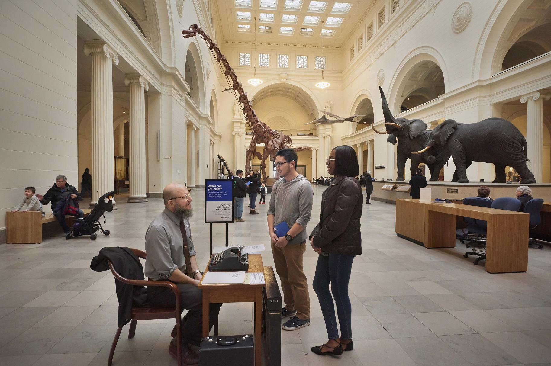 Eric Elshtain talks with visitors in the Field Museum's Stanley Field Hall. (John Weinstein / The Field Museum)