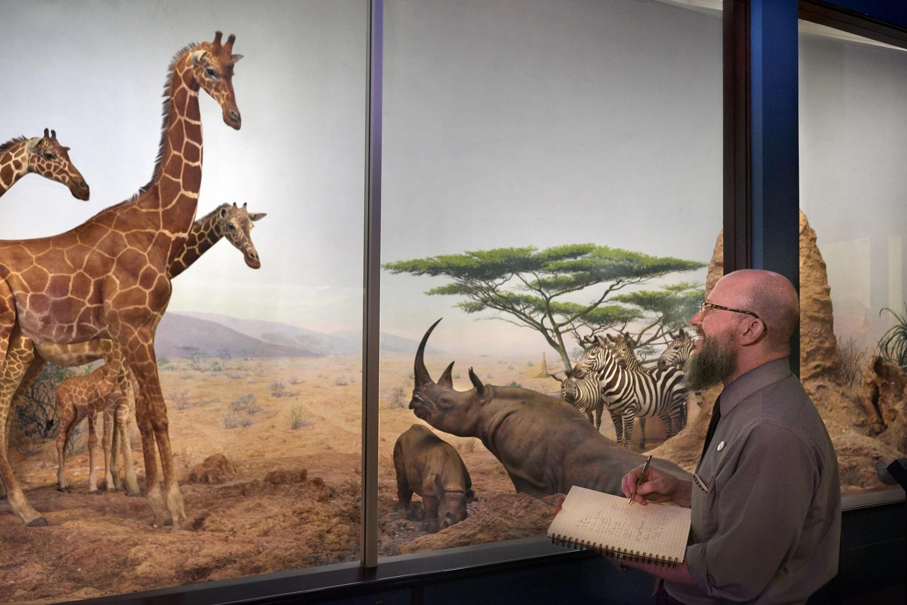 Eric Elshtain takes notes as he tours the Field's exhibits. (John Weinstein / The Field Museum)