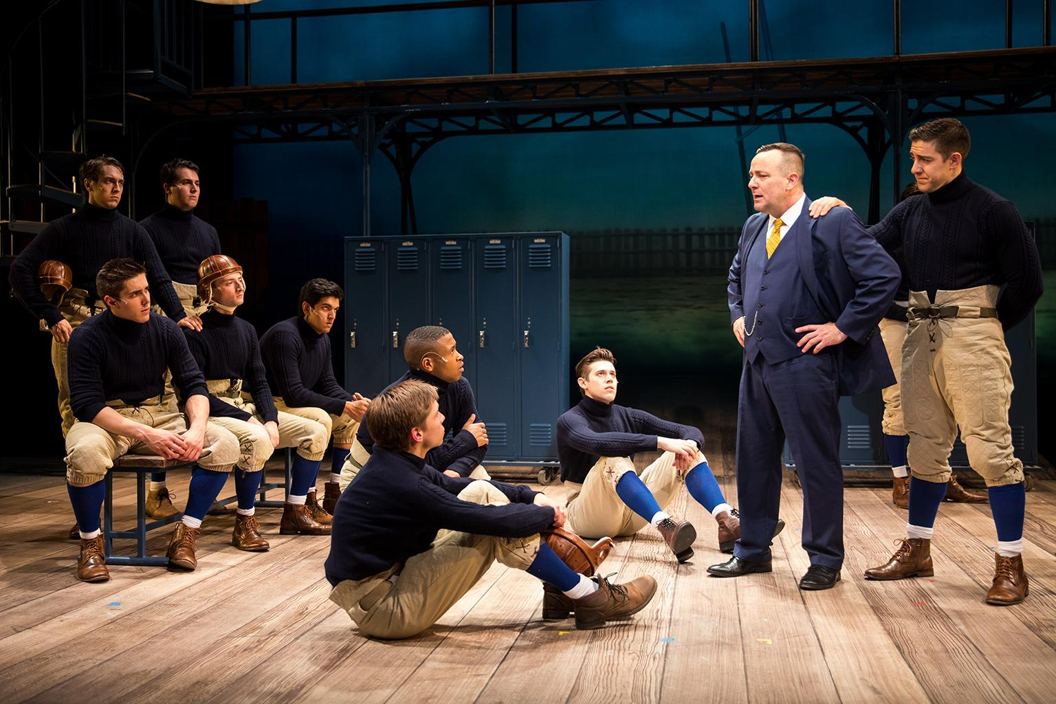 Knute Rockne (Stef Tovar) and George Gipp (Adrian Aguilar) give the Fighting Irish a pep talk. (Credit: Justin Barbin)