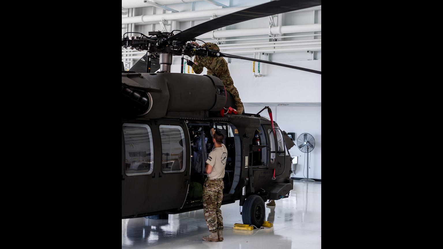 Illinois National Guard soldiers prepare a UH-60 Blackhawk to depart Kankakee in support of Hurricane Florence relief efforts. (Sgt. Stephen Gifford / Illinois National Guard)