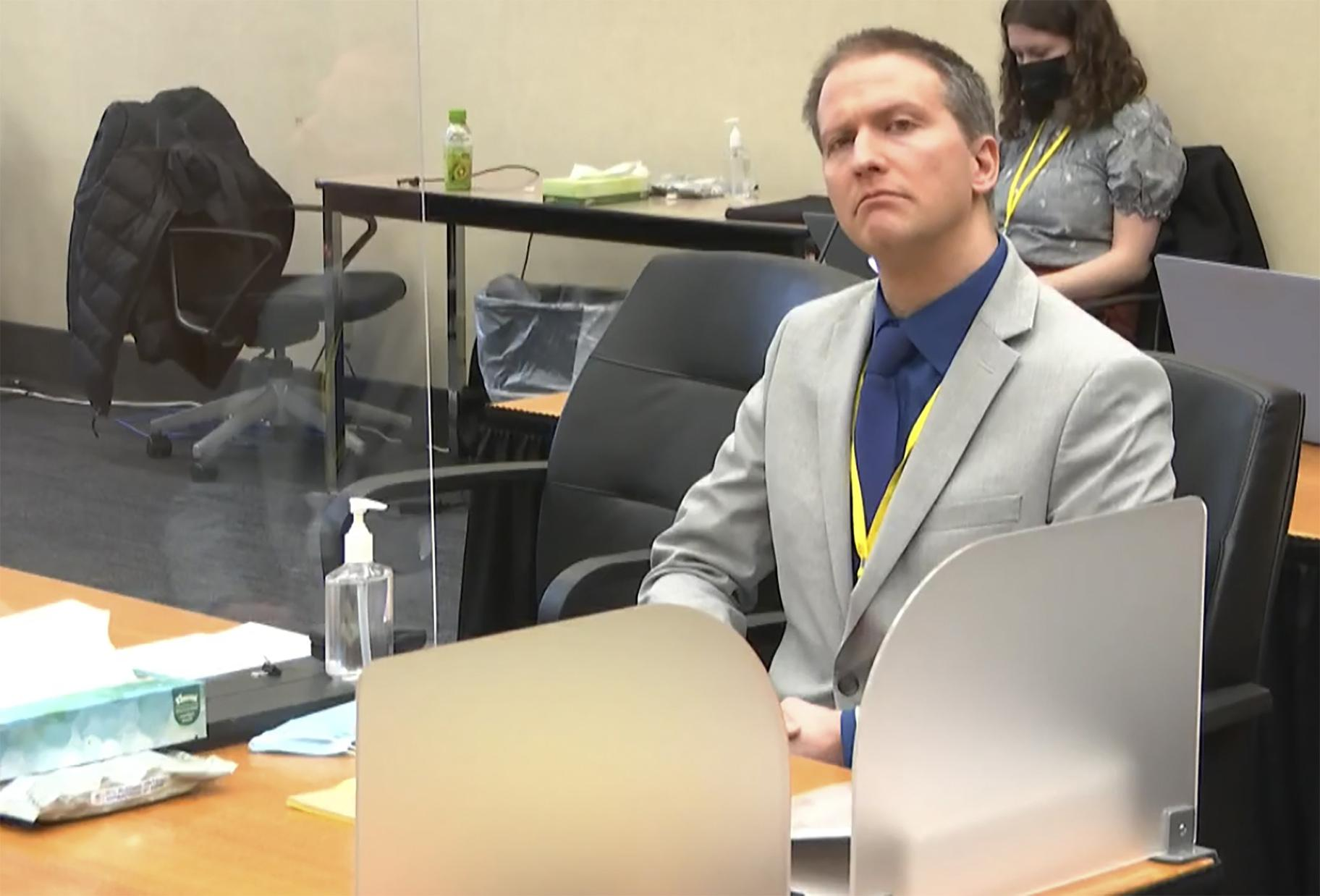 In this image from video, former Minneapolis police Officer Derek Chauvin listens as his defense attorney Eric Nelson gives closing arguments as Hennepin County Judge Peter Cahill preside Monday, April 19, 2021, in the trial of Chauvin at the Hennepin County Courthouse in Minneapolis. (Court TV via AP, Pool)