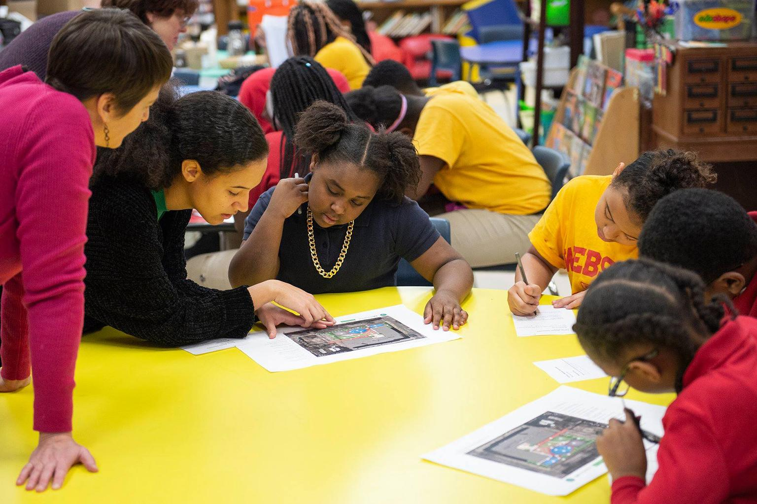 Students and teachers at Webster Elementary School in the Lawndale neighborhood review plans for a new schoolyard funded through the Space to Grow initiative. (Courtesy Metropolitan Water Reclamation District of Greater Chicago)