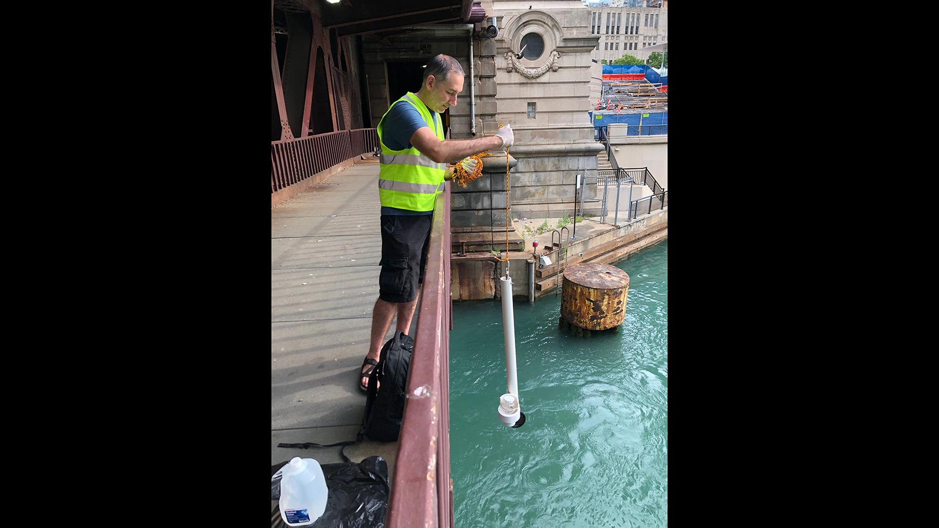 Steve Frenkel, Current's executive director, conducts water sampling in the Chicago River. (Courtesy Current)