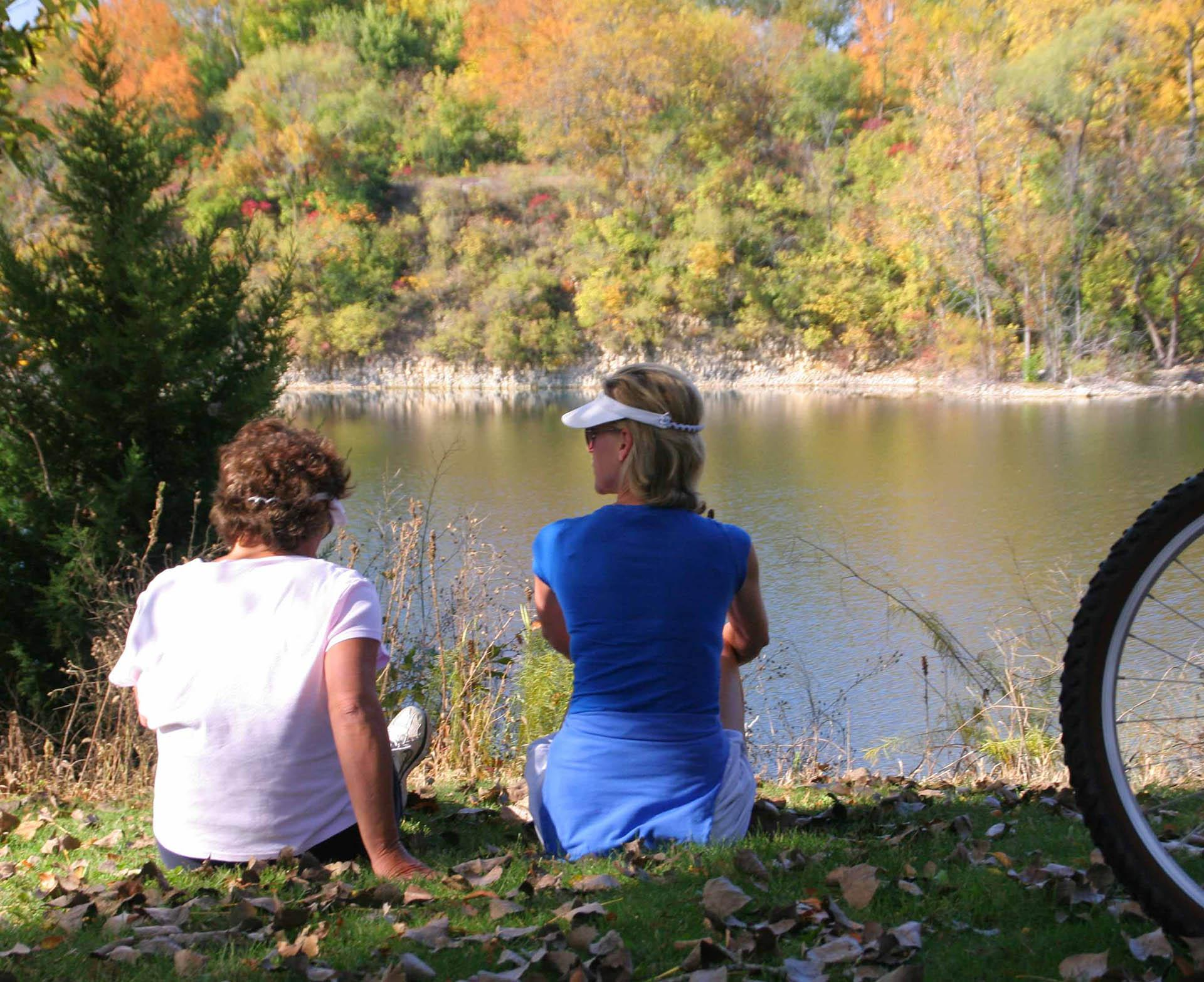 Bicyclists enjoy a relaxing break overlooking the quarry lake at Headquarters Forest Preserve which is the trailhead for the Rock River Recreation Path. (Photo by Jamie B. Johannsen)