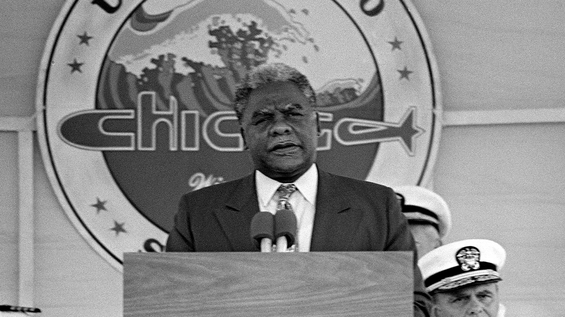 Chicago Mayor Harold Washington speaks during the commissioning of the nuclear-powered attack submarine USS Chicago in September 1986 in Norfolk, Virginia.
